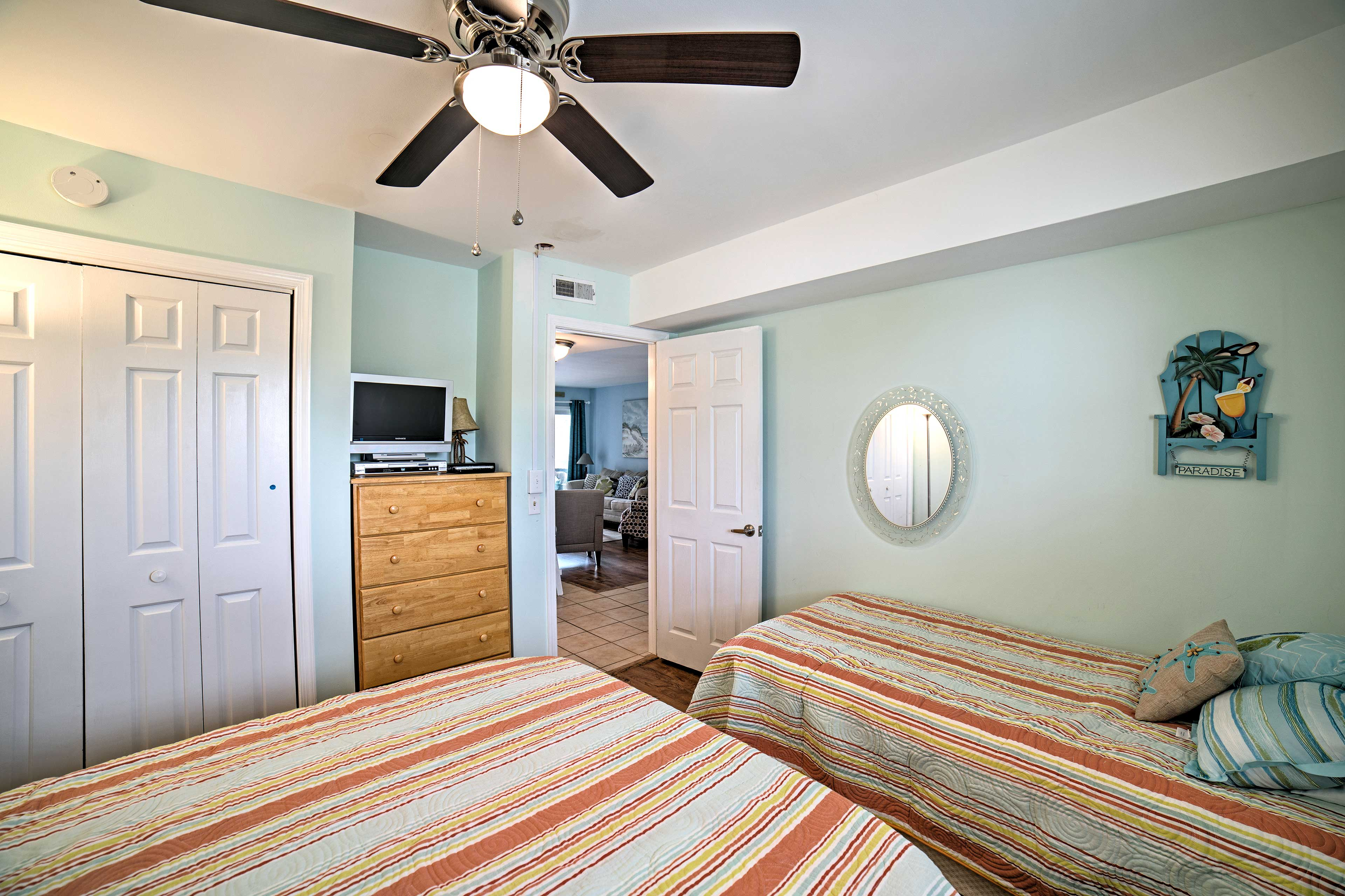 The room also boasts a flat-screen cable TV and storage space.