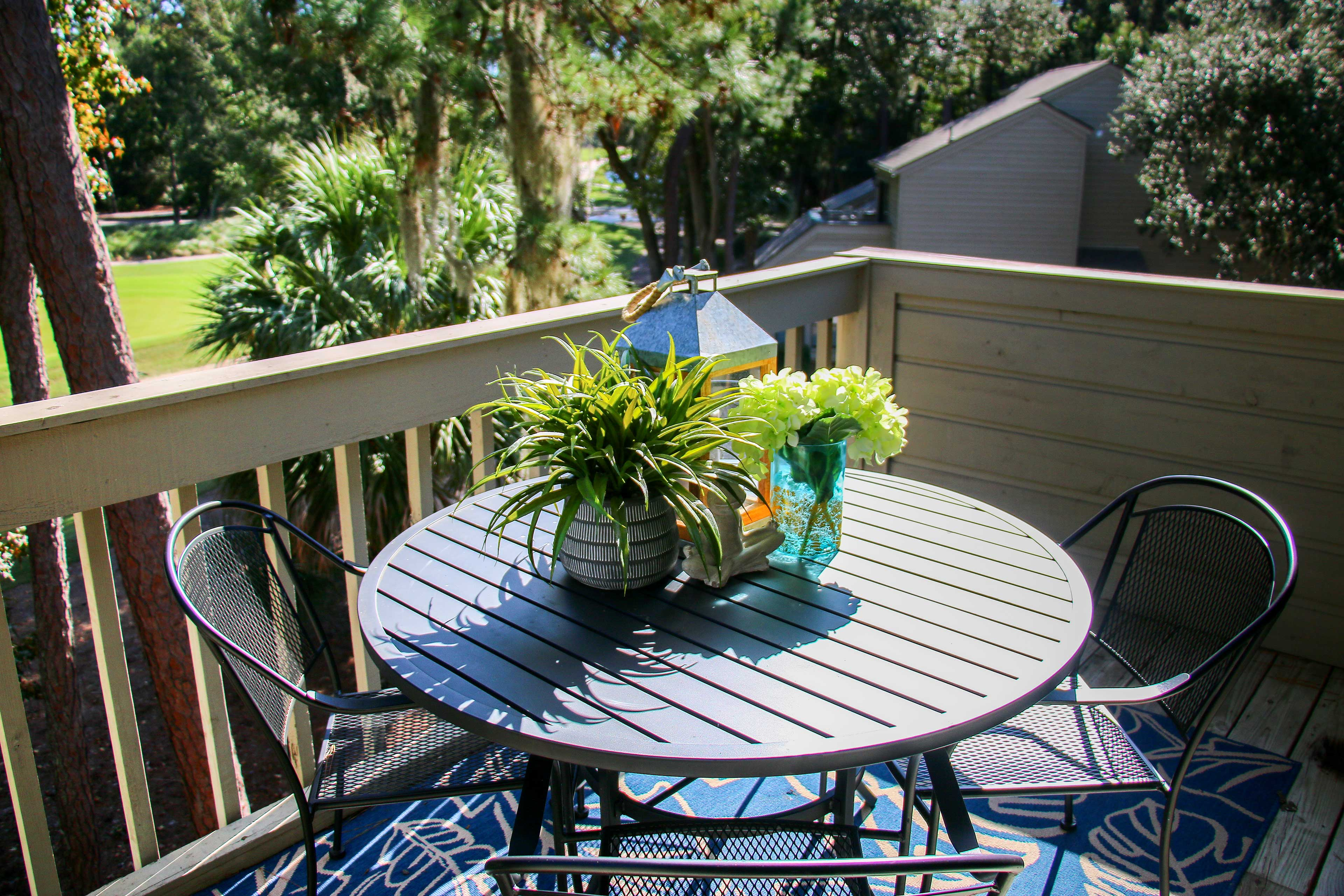 The 1bed, 1-bath condo for 4 looks out to the Racquet Club Villas golf course.