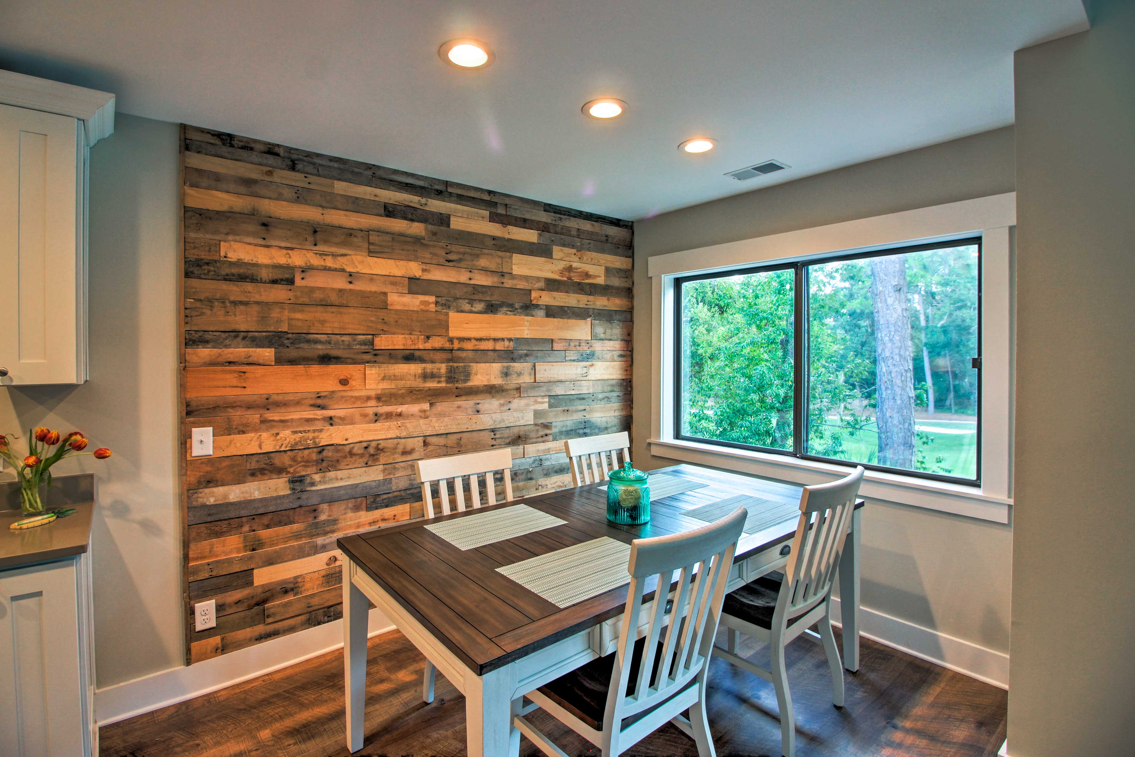 The dining area features a custom reclaimd wood accent wall.