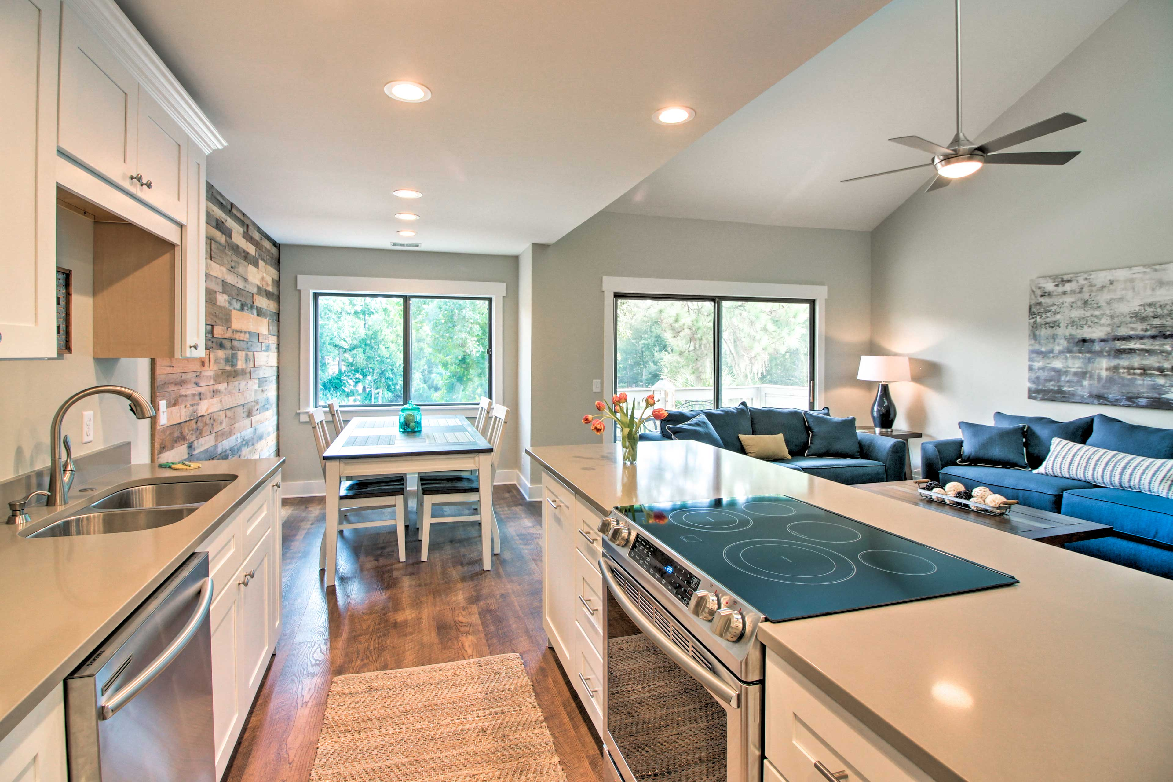 Quartzite countertops and stainless steel appliances make cooking a breeze.
