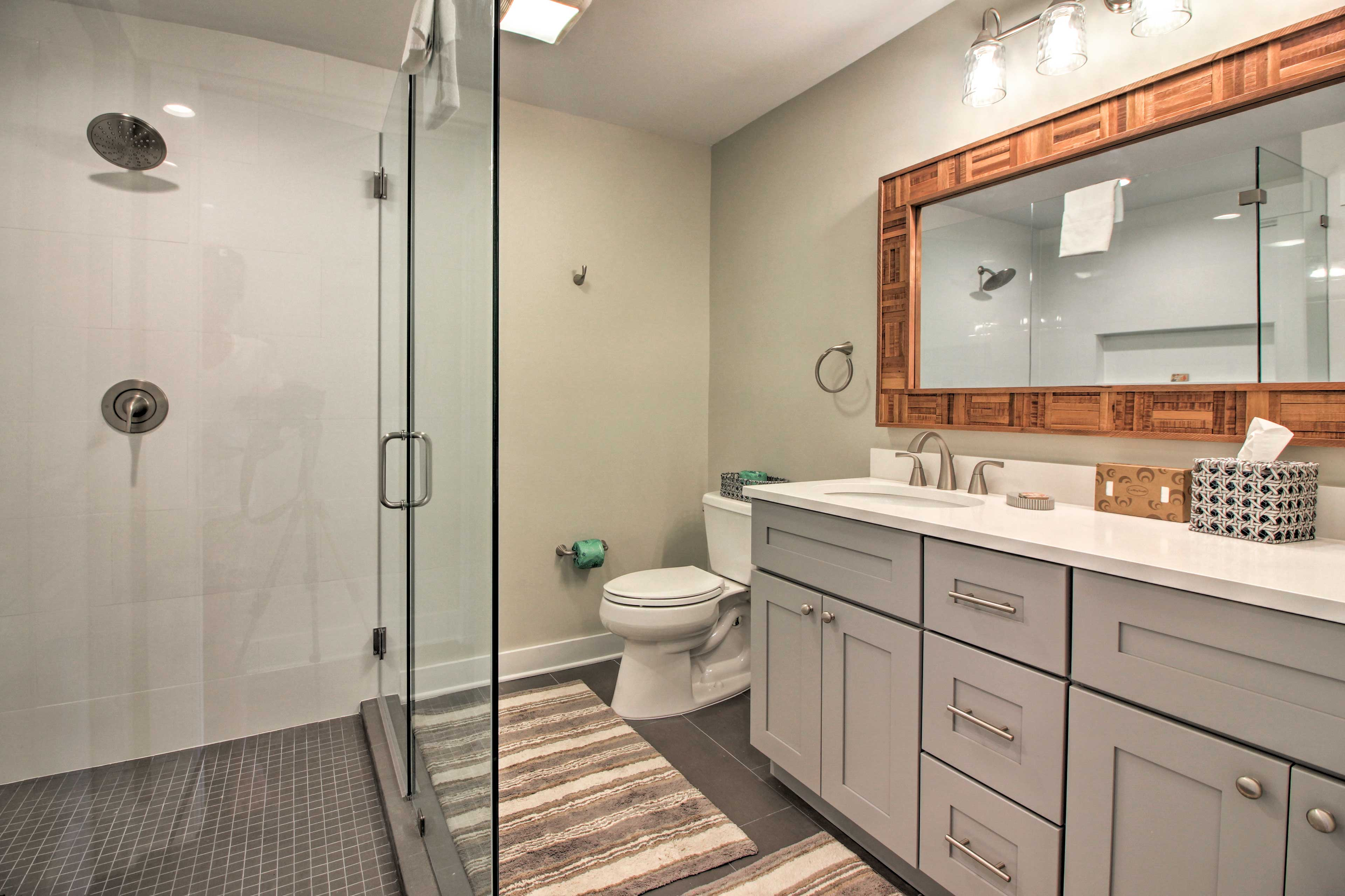 The bathroom includes a rain tree shower head and double sinks.