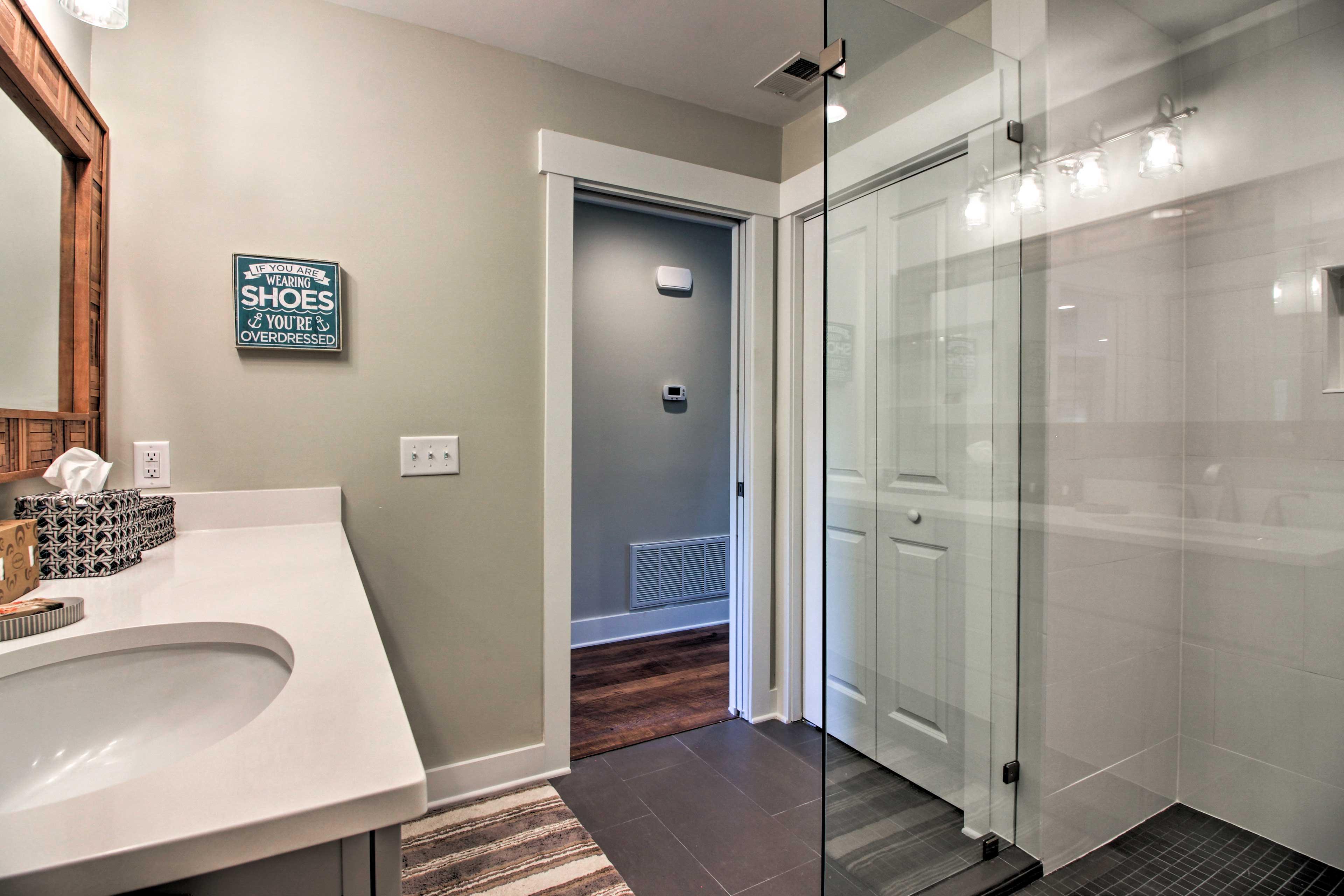 Freshen up in the custom-tiled walk-in shower.