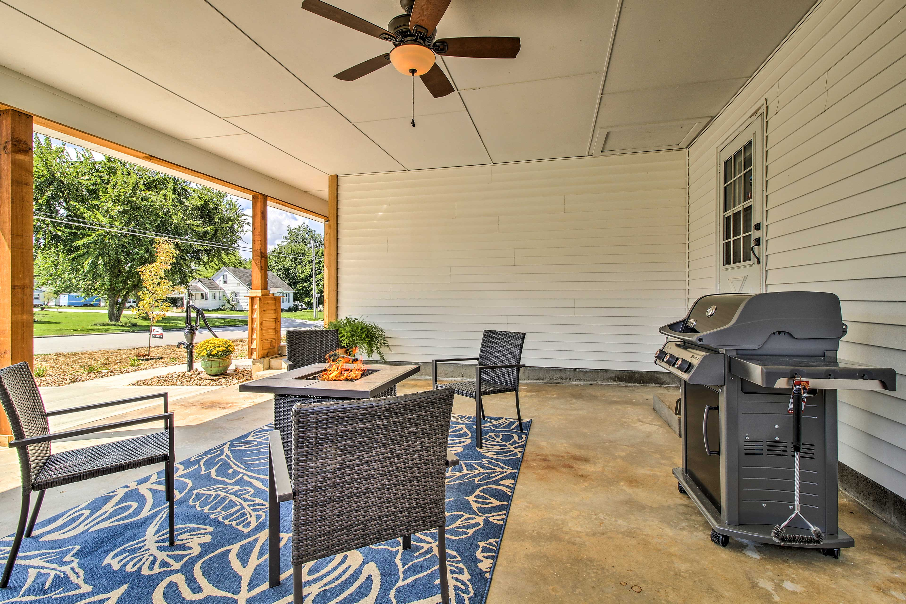 The outdoor space includes seating, a fire pit and a gas grill!