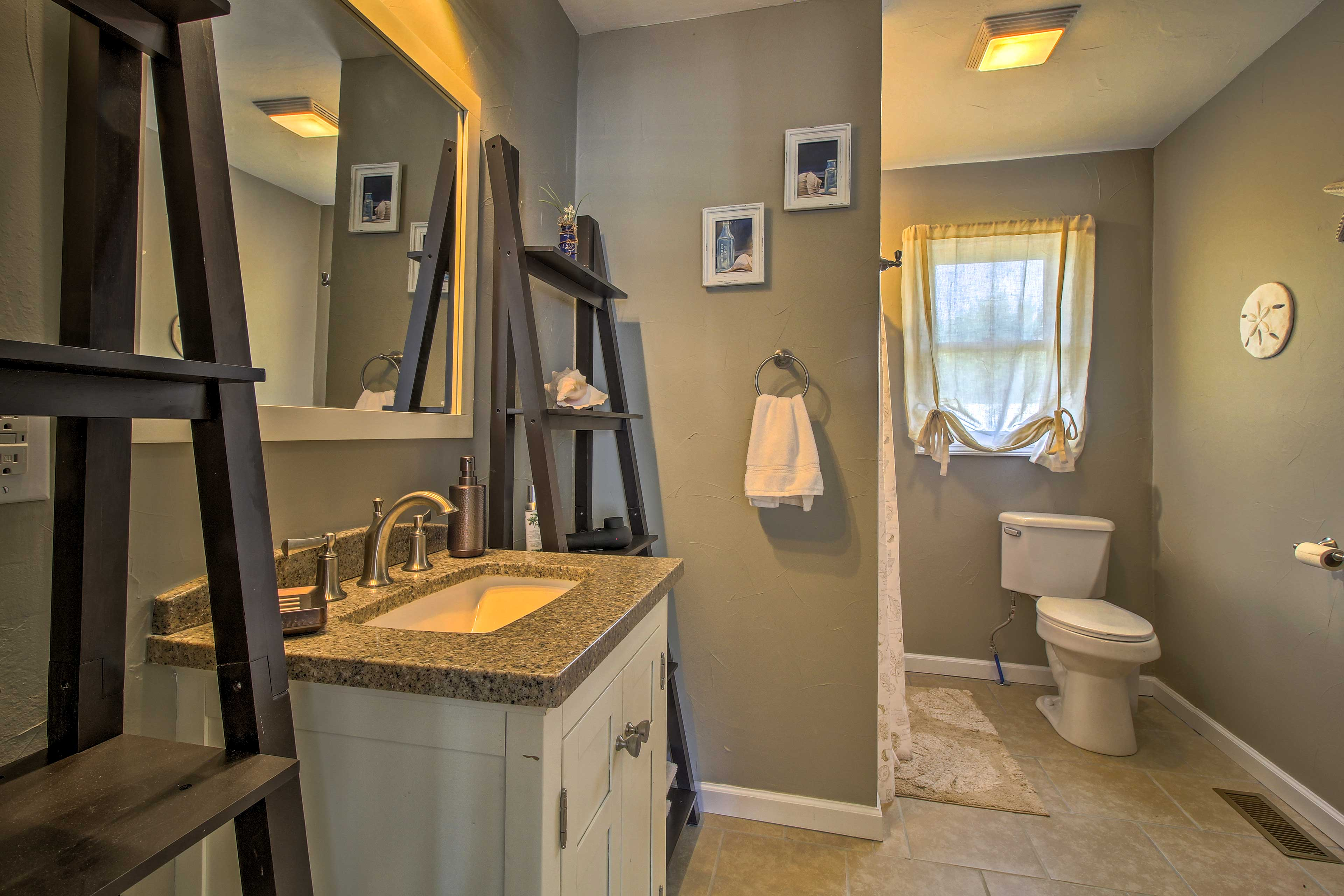 Rinse off in this large full bathroom.