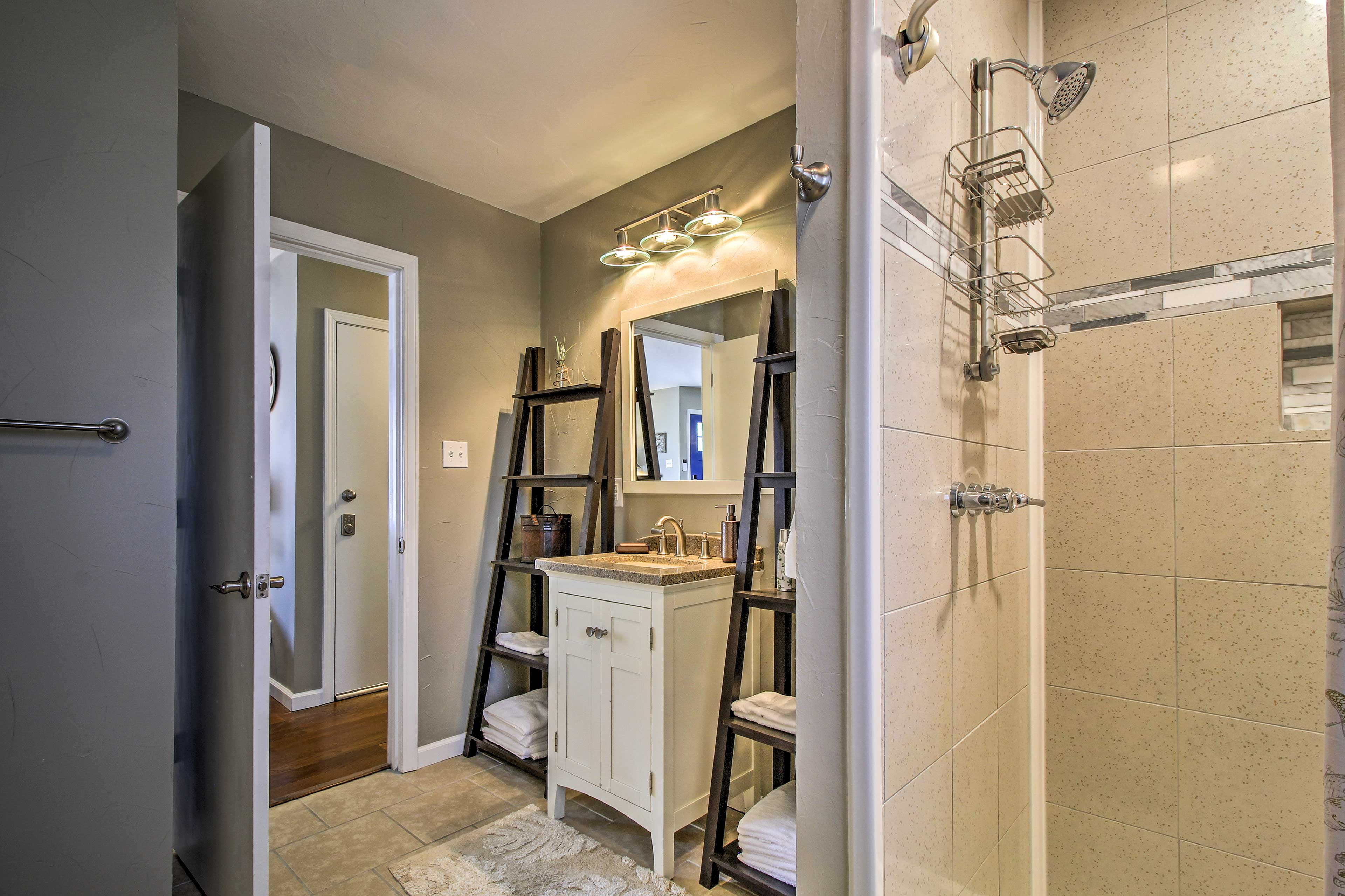 Fresh towels and linens are provided in the hallway bath with a walk-in shower.