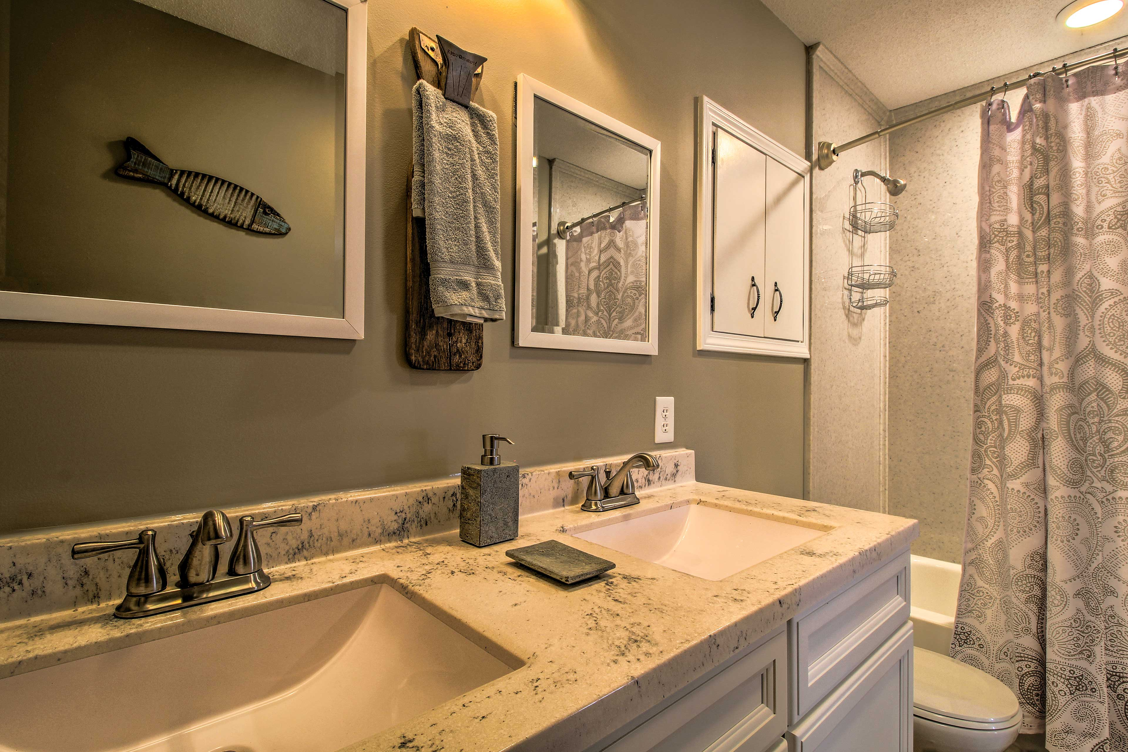 Double vanities and a shower/tub combo complete the master bathroom.