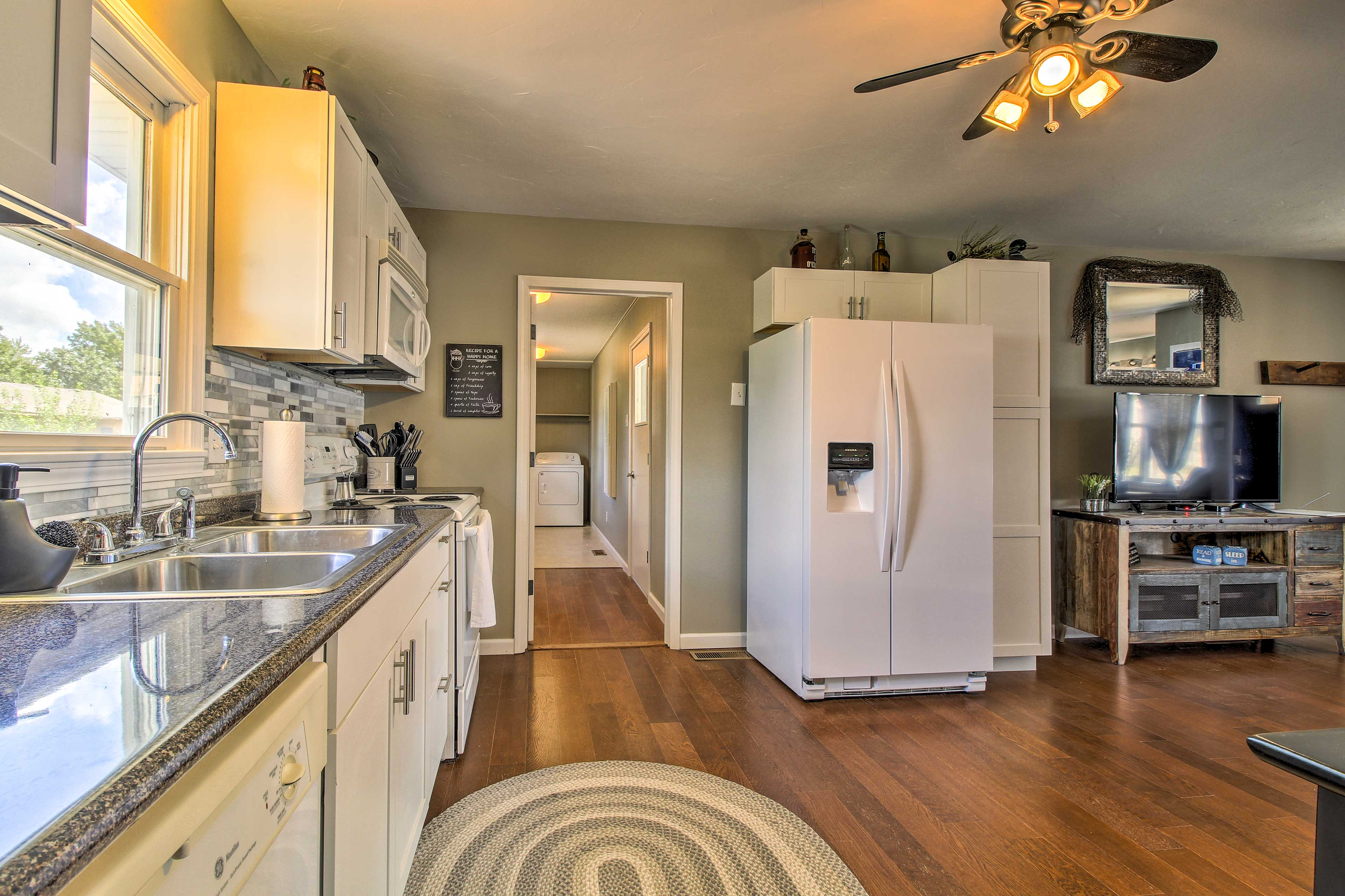 You'll find in-unit laundry machines down the hall.