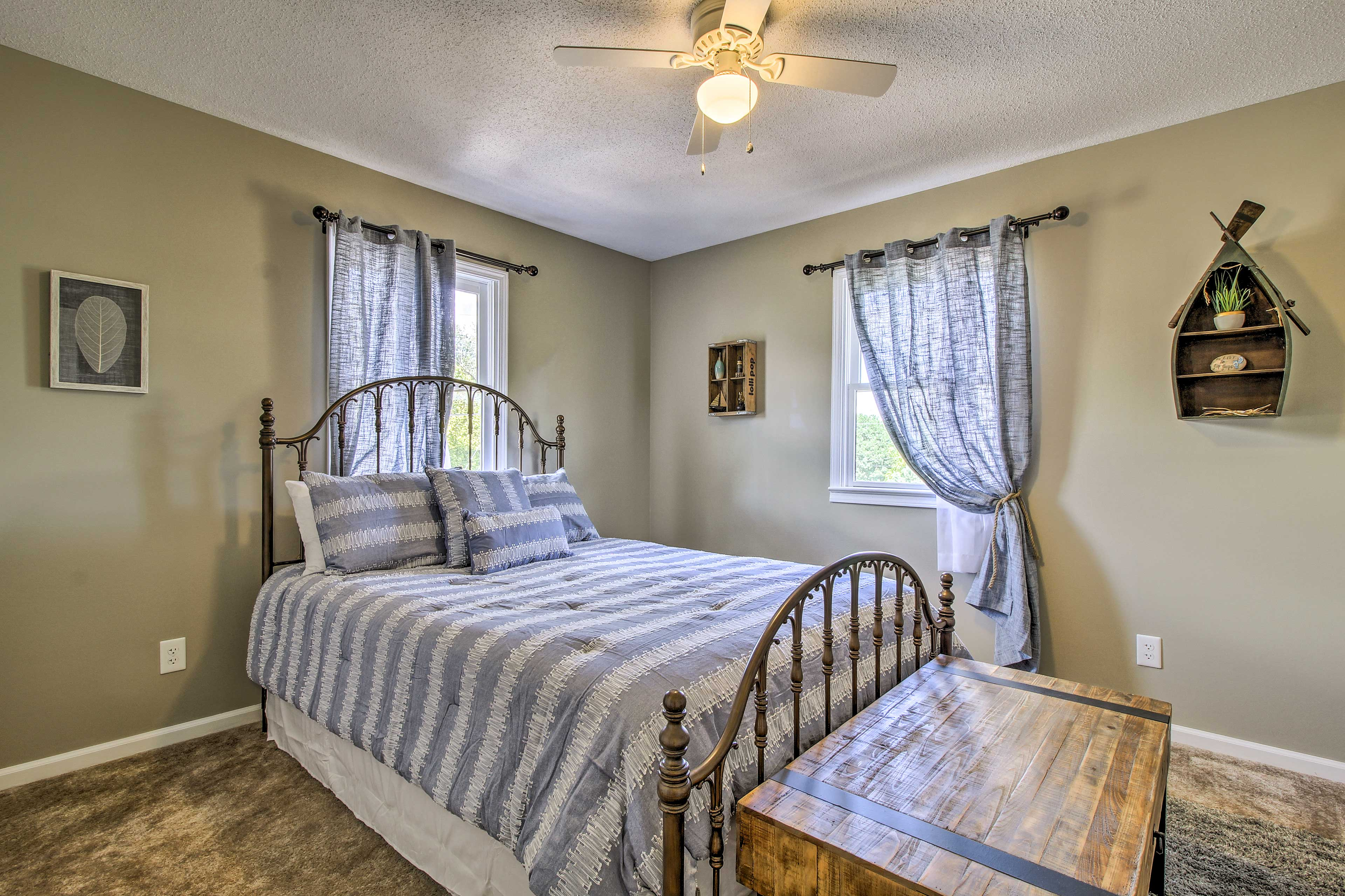 This lovely bedroom features a queen bed.