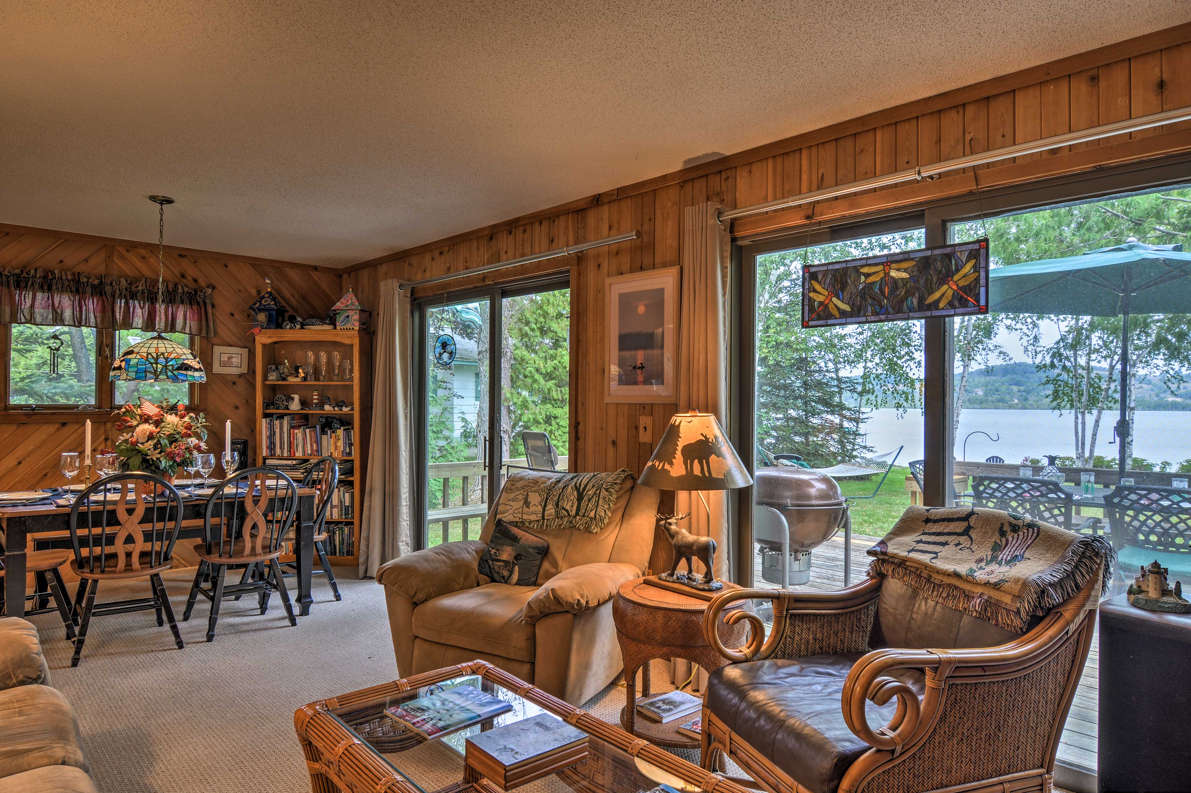 Two sets of sliding glass doors afford water views and access to the deck.
