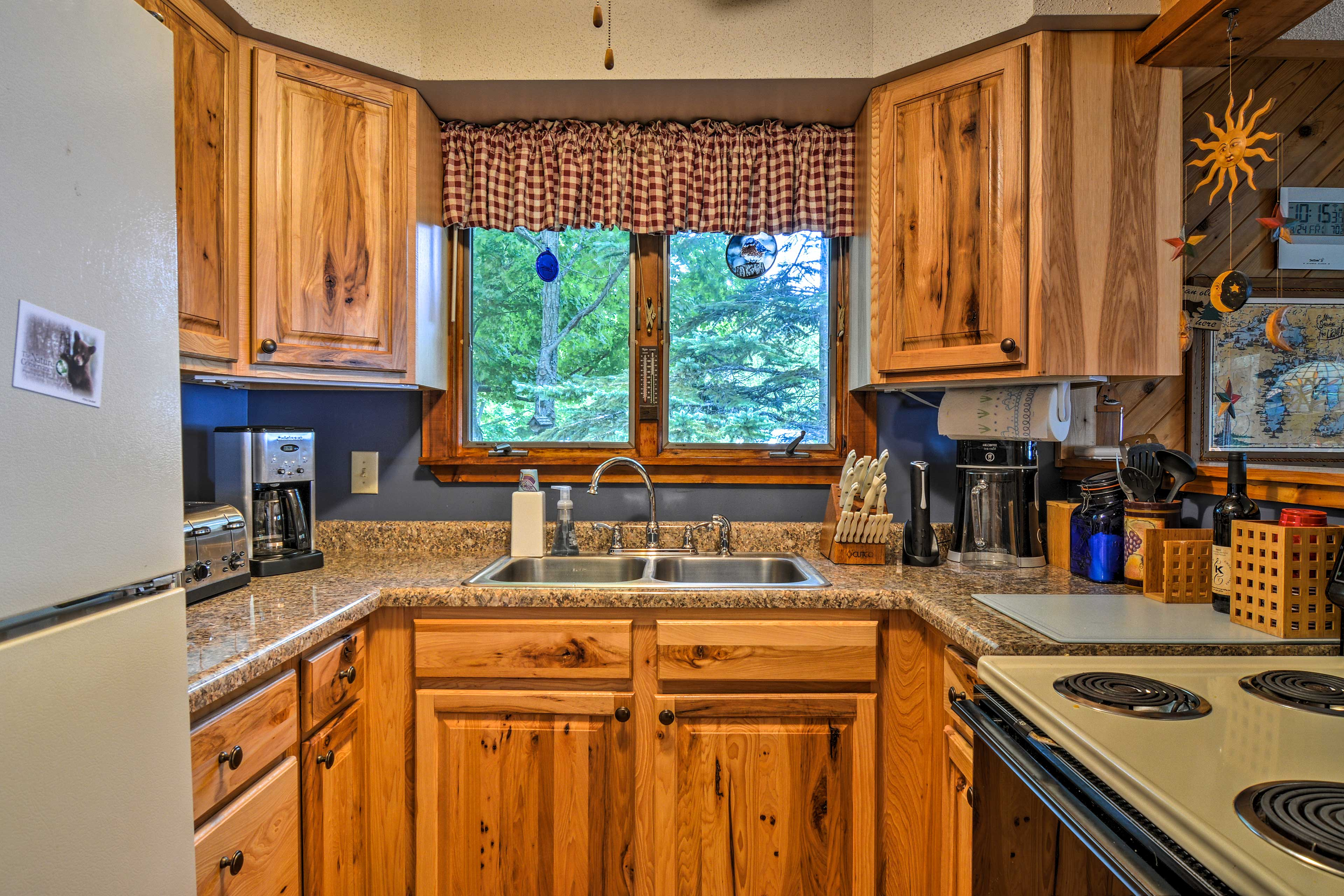 The well-equipped kitchen boasts wraparound counters.