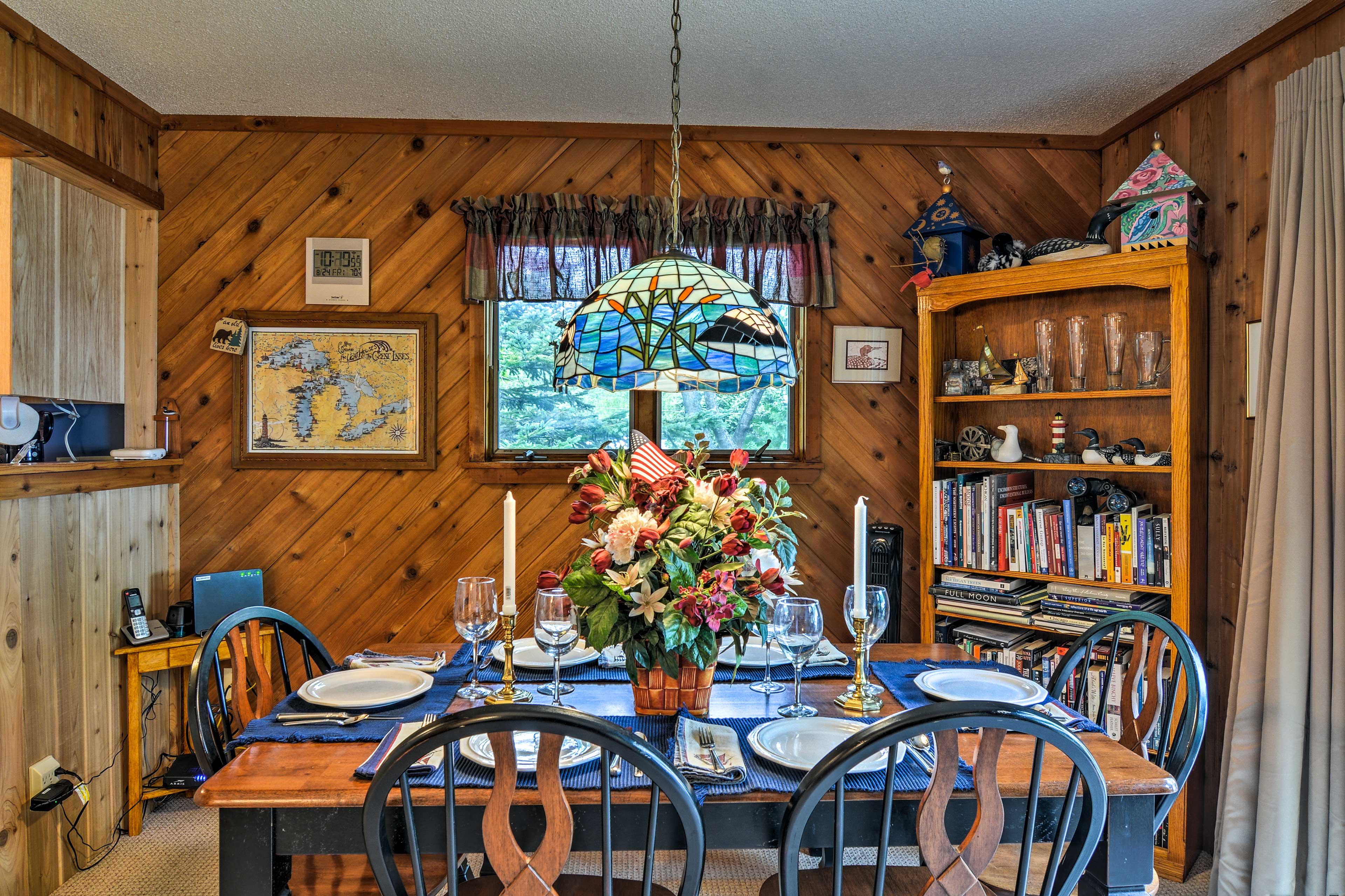 Gather around the 5-person dining table to enjoy your meals together.