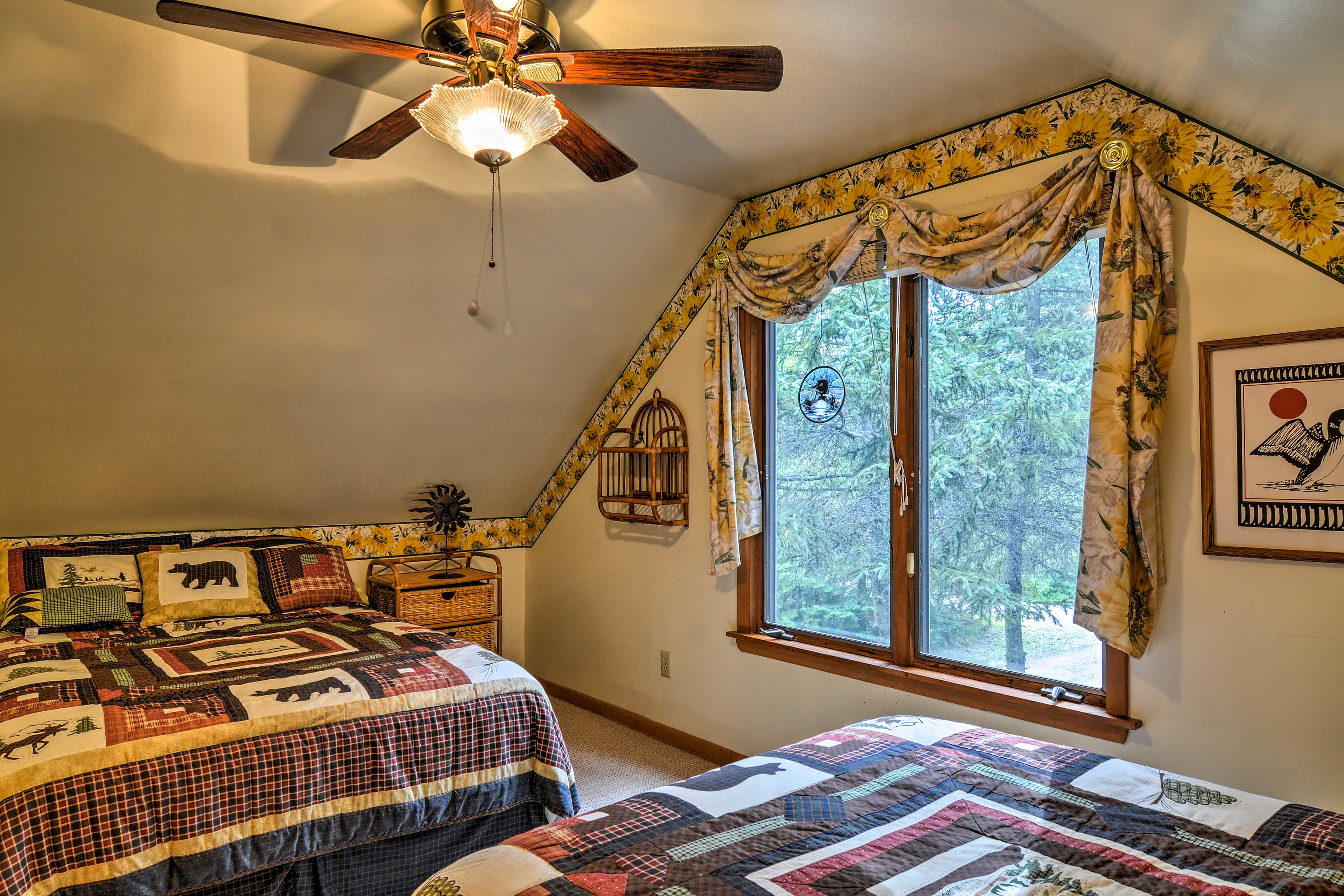 The second upstairs bedroom hosts 2 full beds.