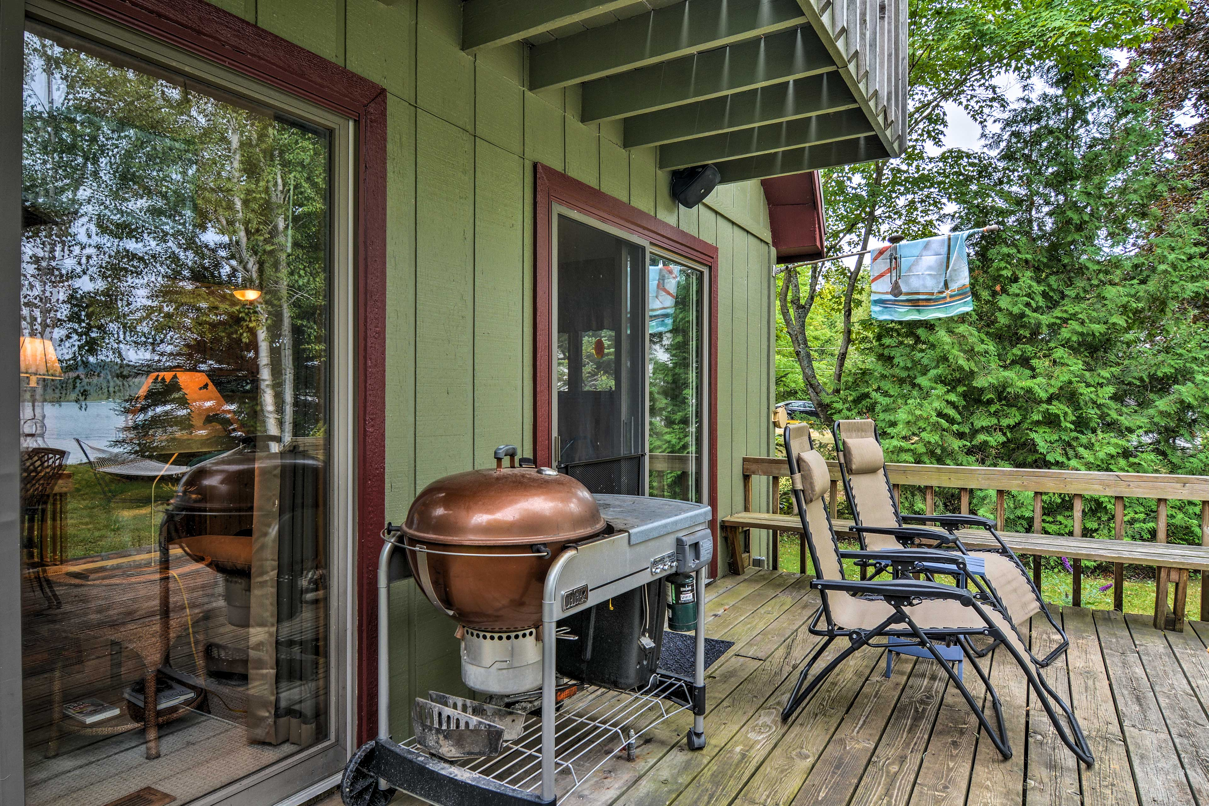 Use the charcoal grill to cook up some hamburgers for a summer barbecue.