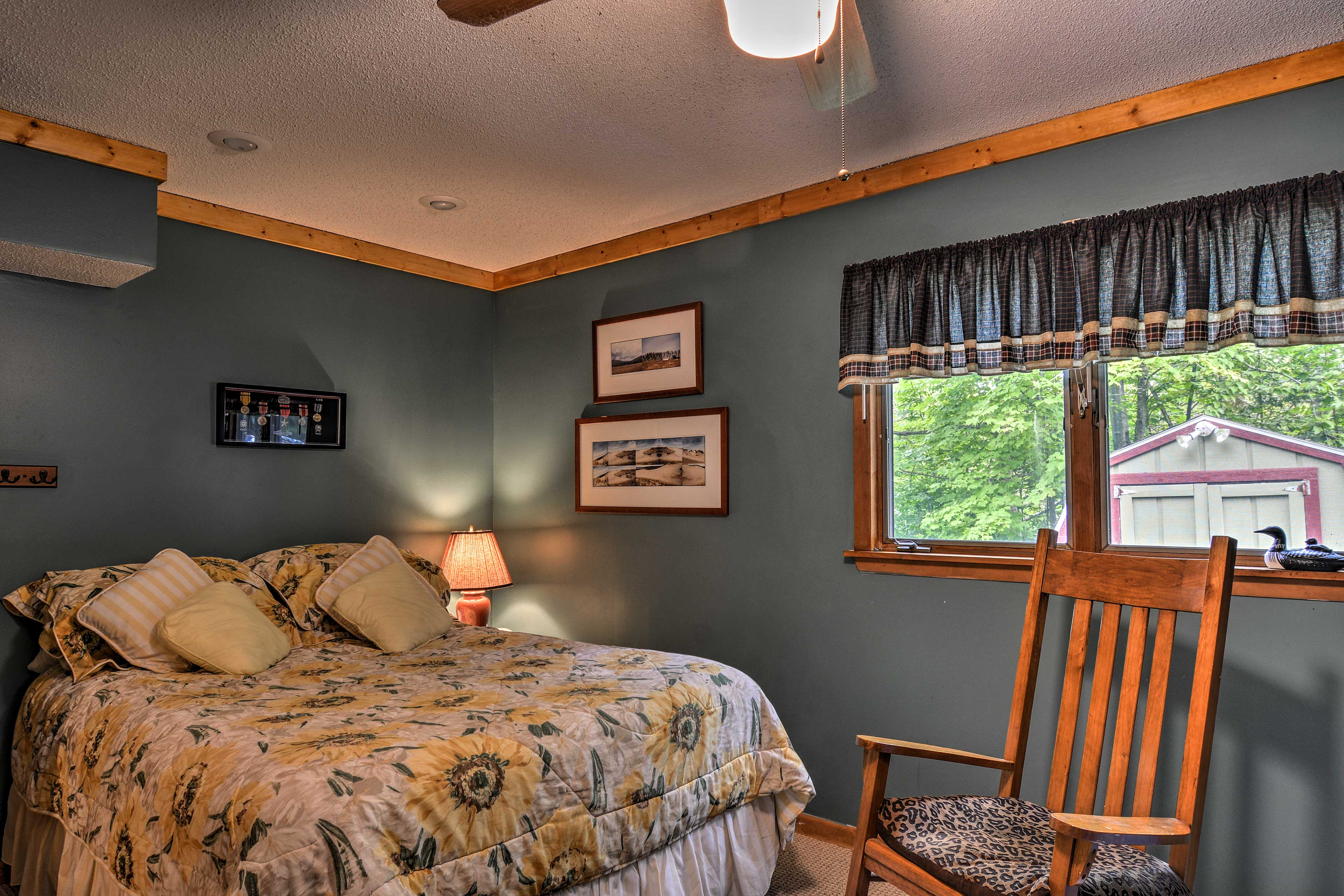 Downstairs, the third bedroom offers a queen bed and twin-over-twin bunk bed.