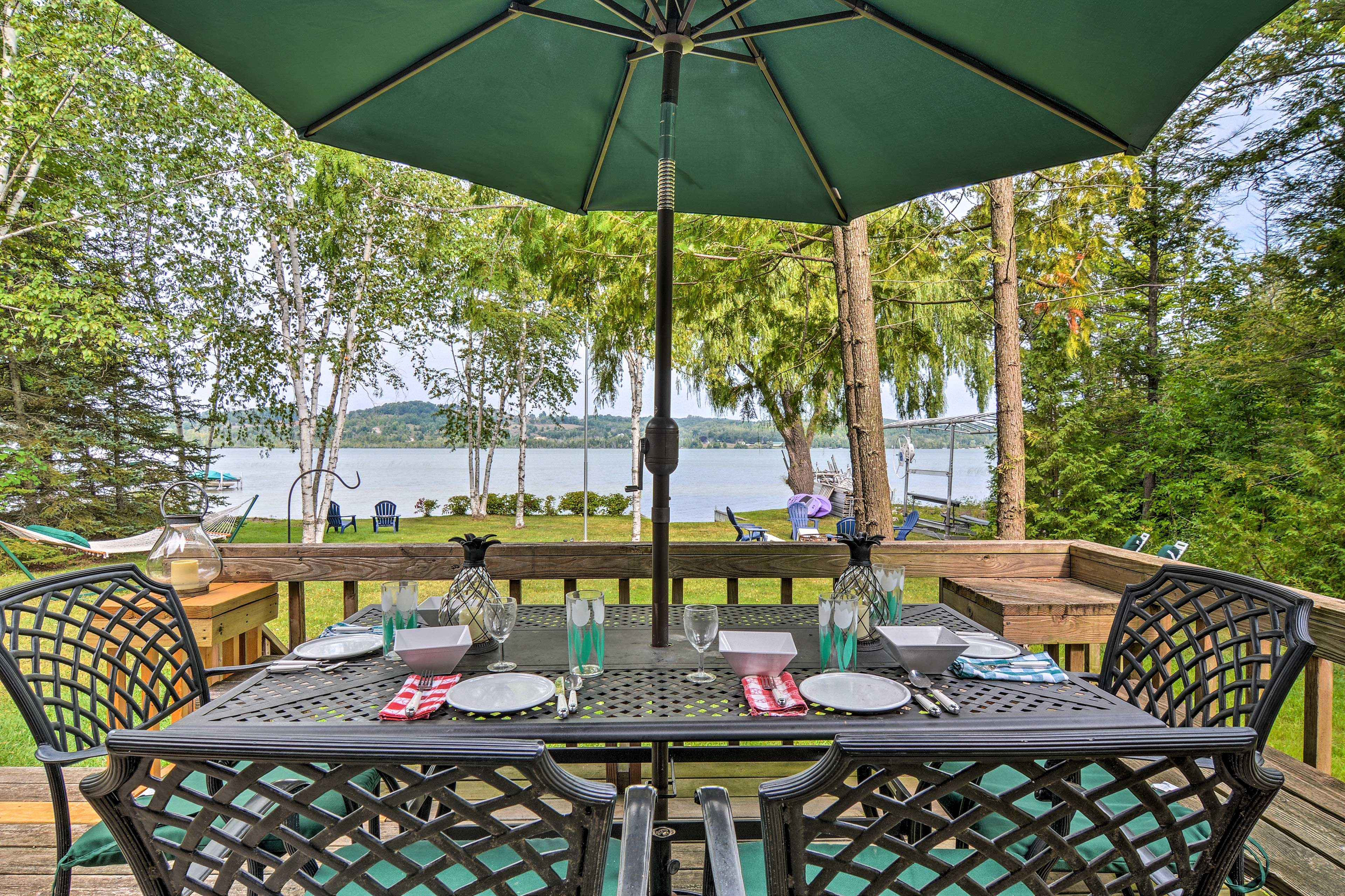 Set along the back of the house, the deck boasts a 4-person wrought iron table.