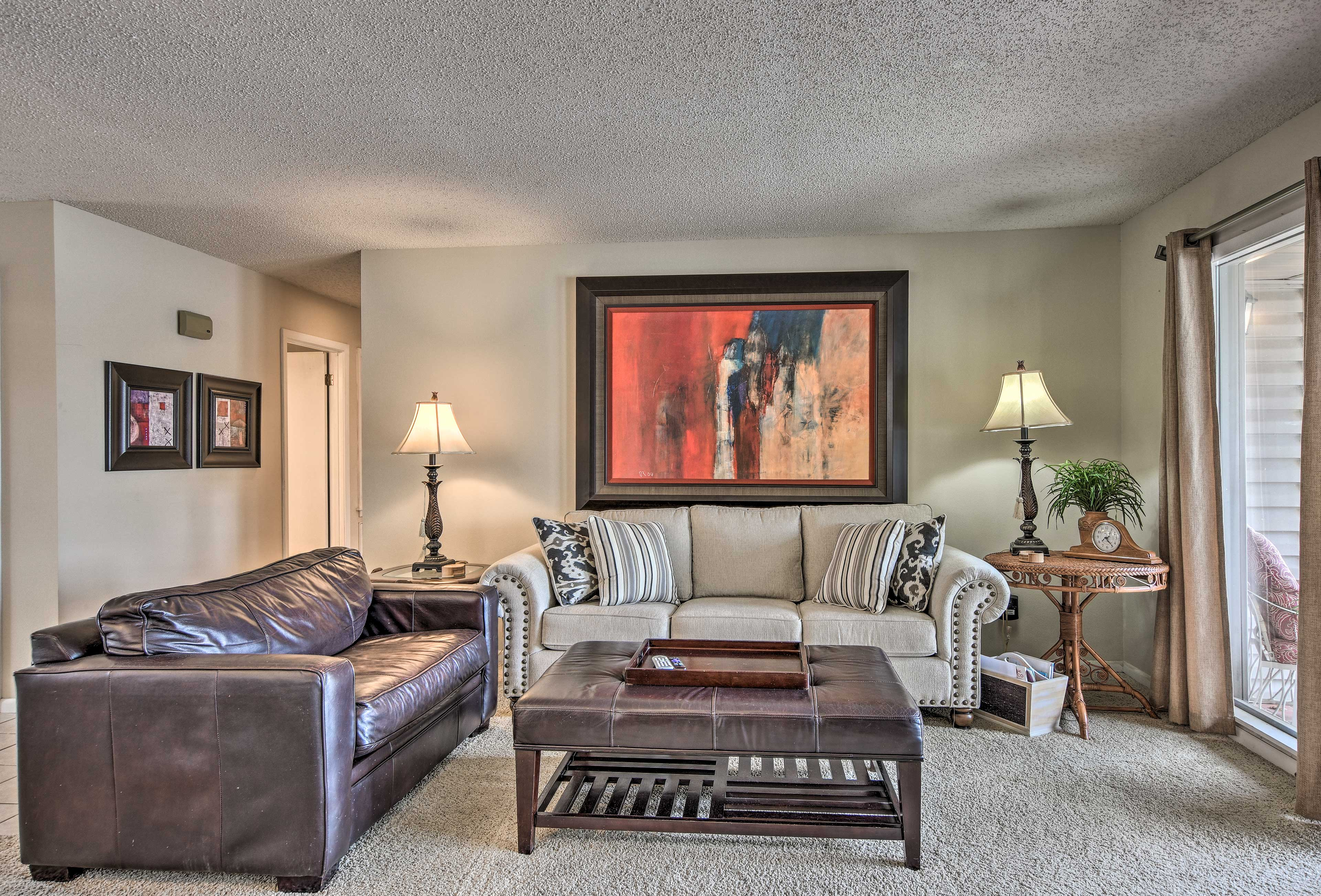 The living room provides additional sleeping on the pullout sofa and chair.
