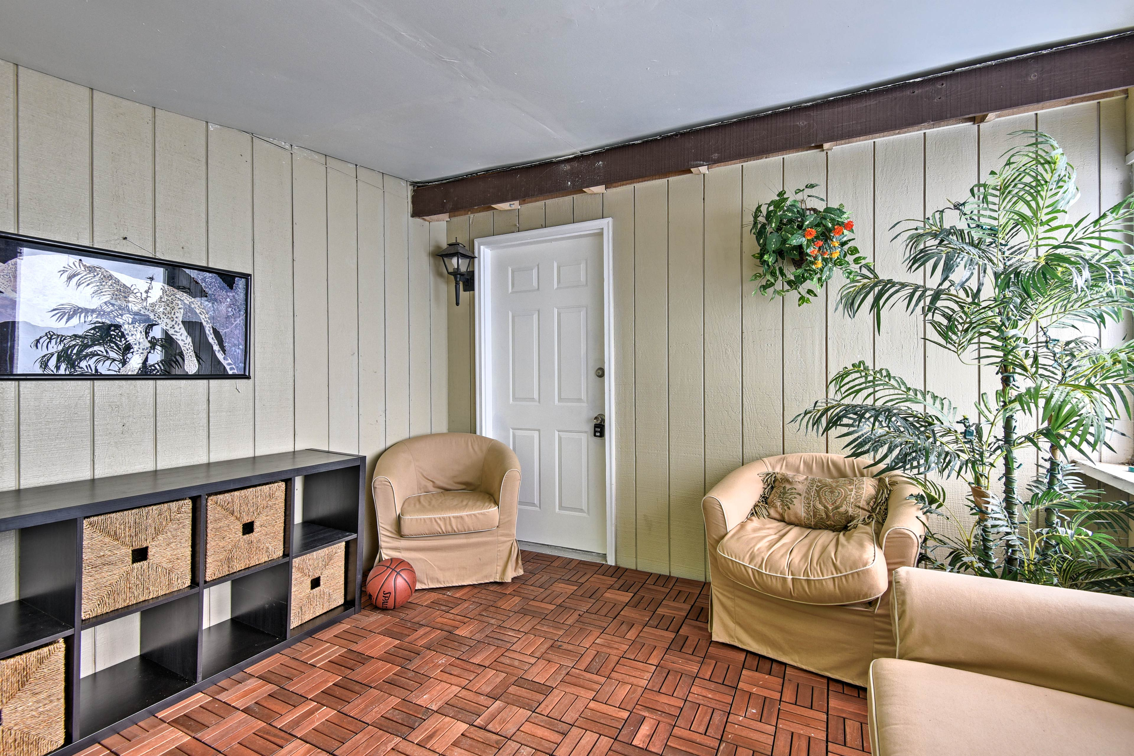 Seek solace in the furnished sunroom.