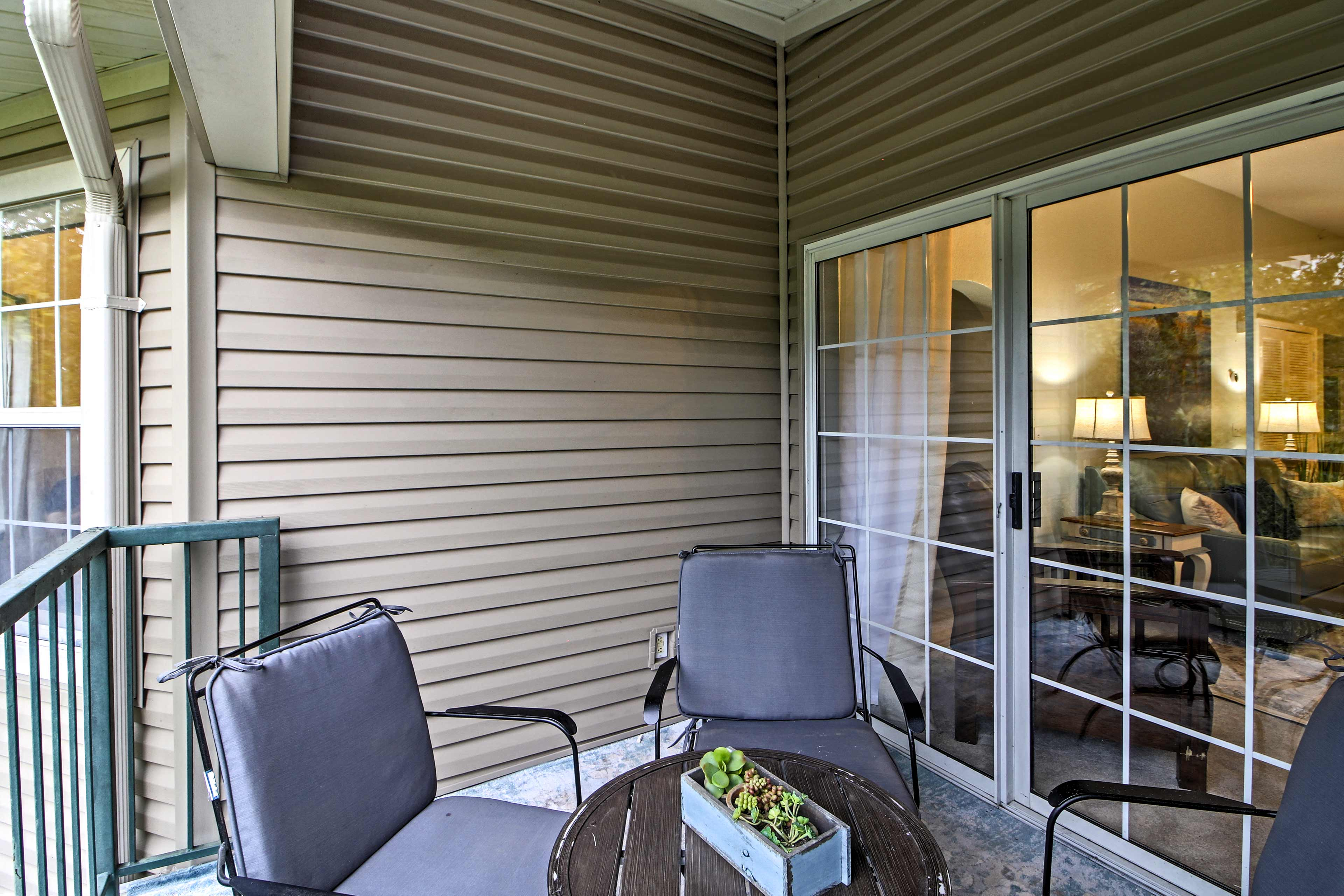 Sip a nightcap on the private balcony featuring ample seating.