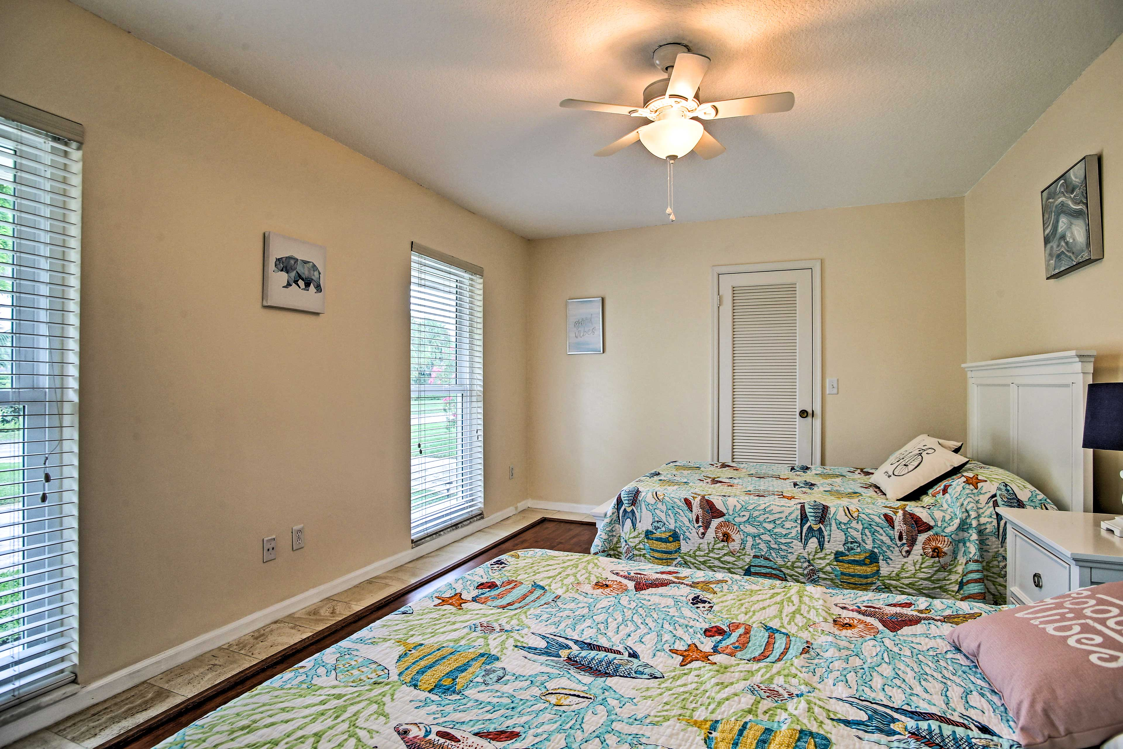 This bedroom includes 2 full-sized beds.