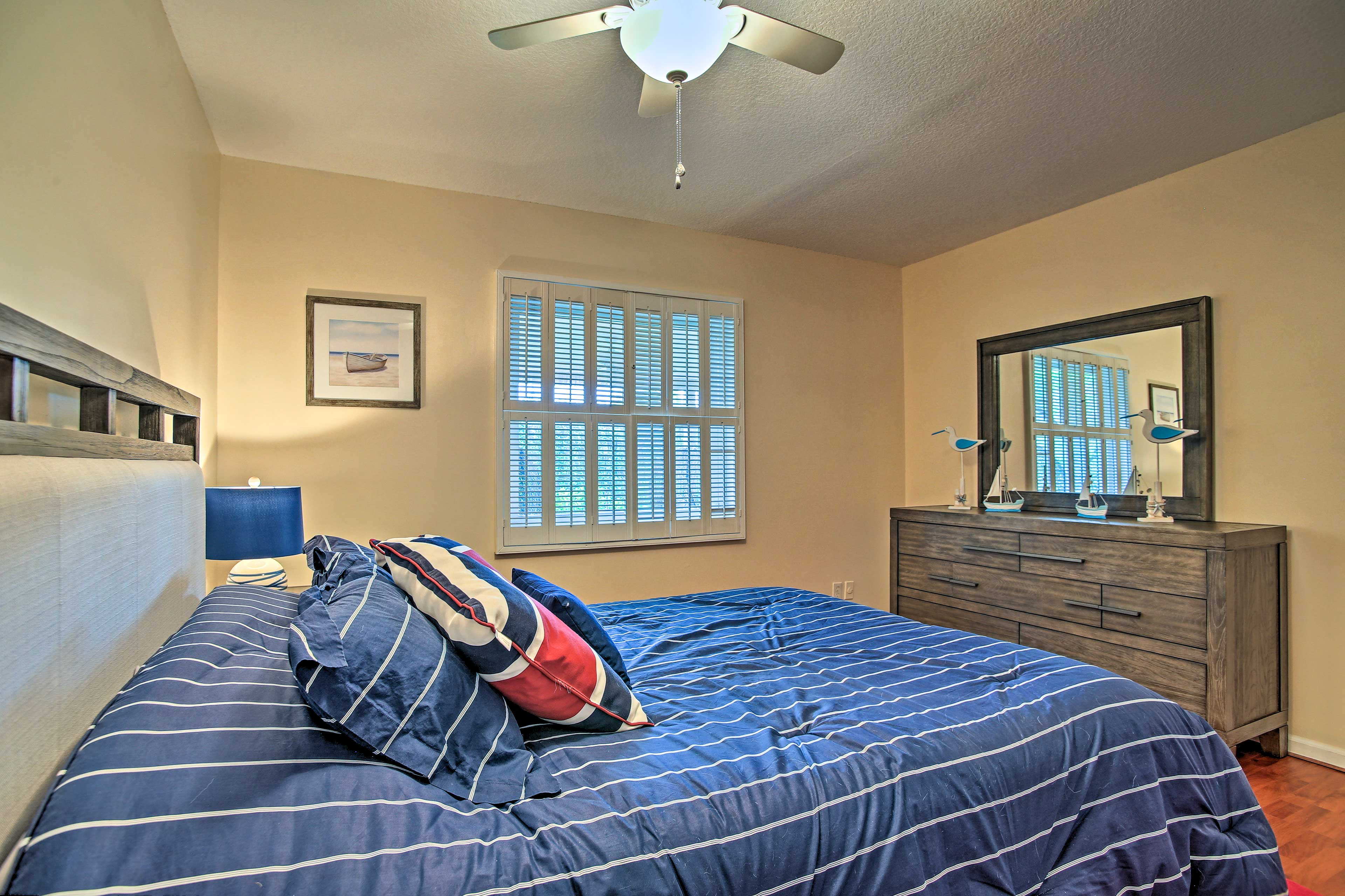 The room features a queen-sized bed.
