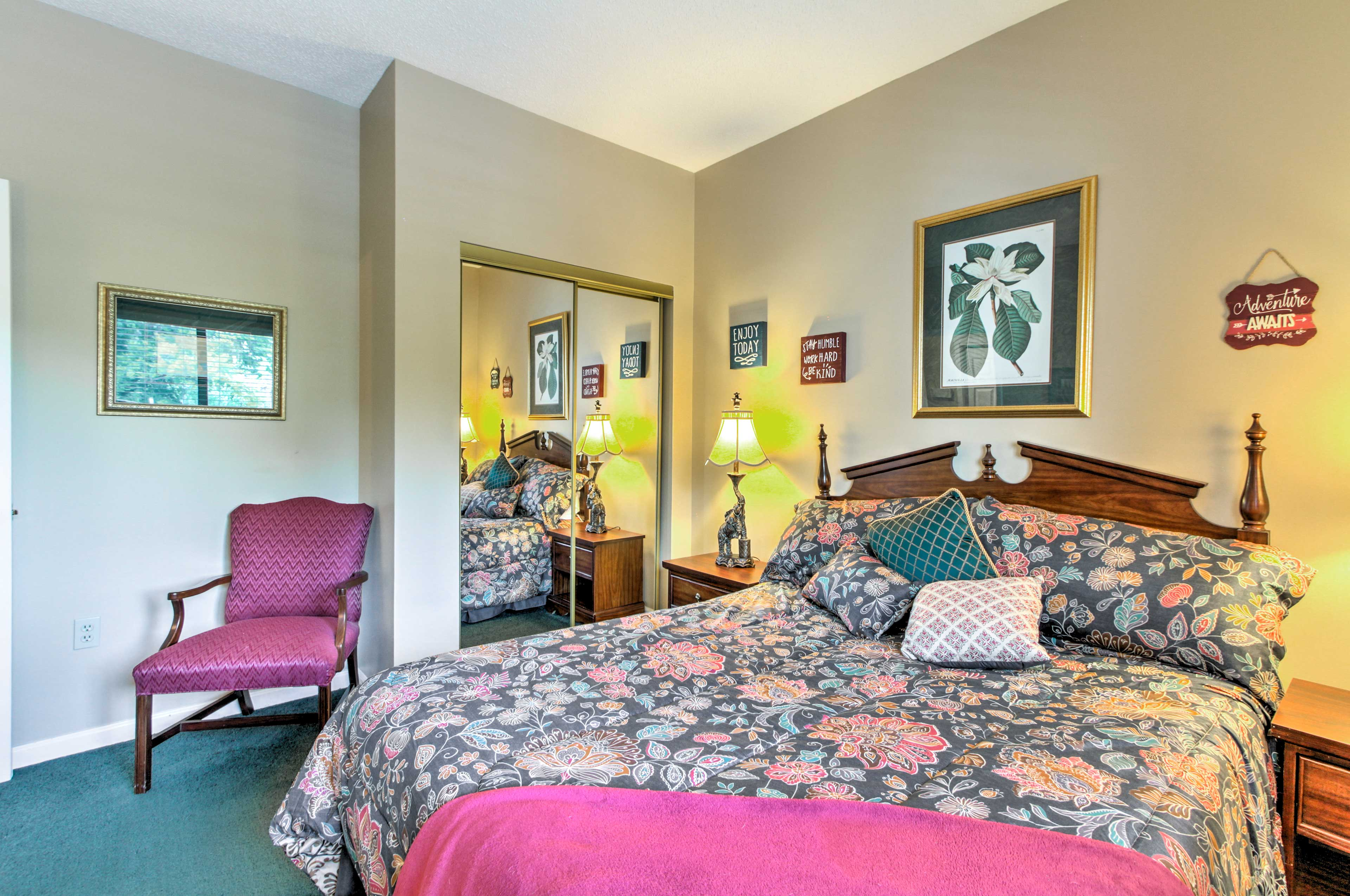 The guest bedroom offers a queen-sized bed.