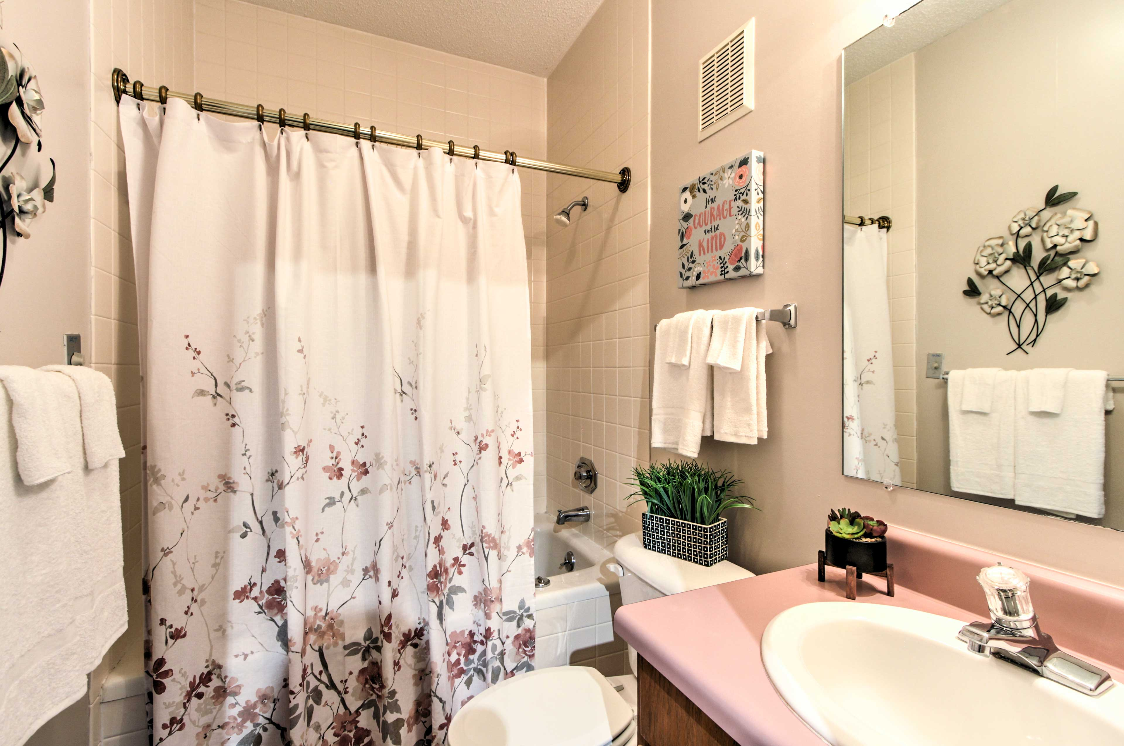 Both bathrooms feature jetted tubs.