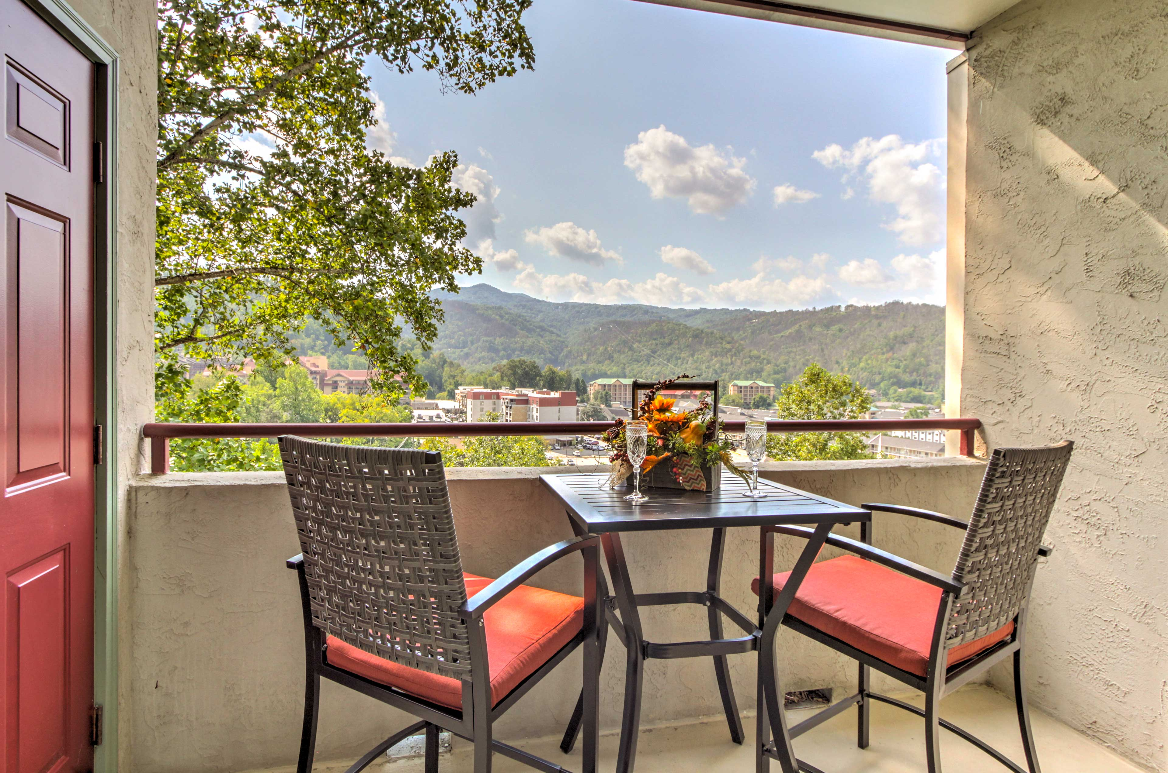 The separate balcony offers a charming cafe table and stunning views.