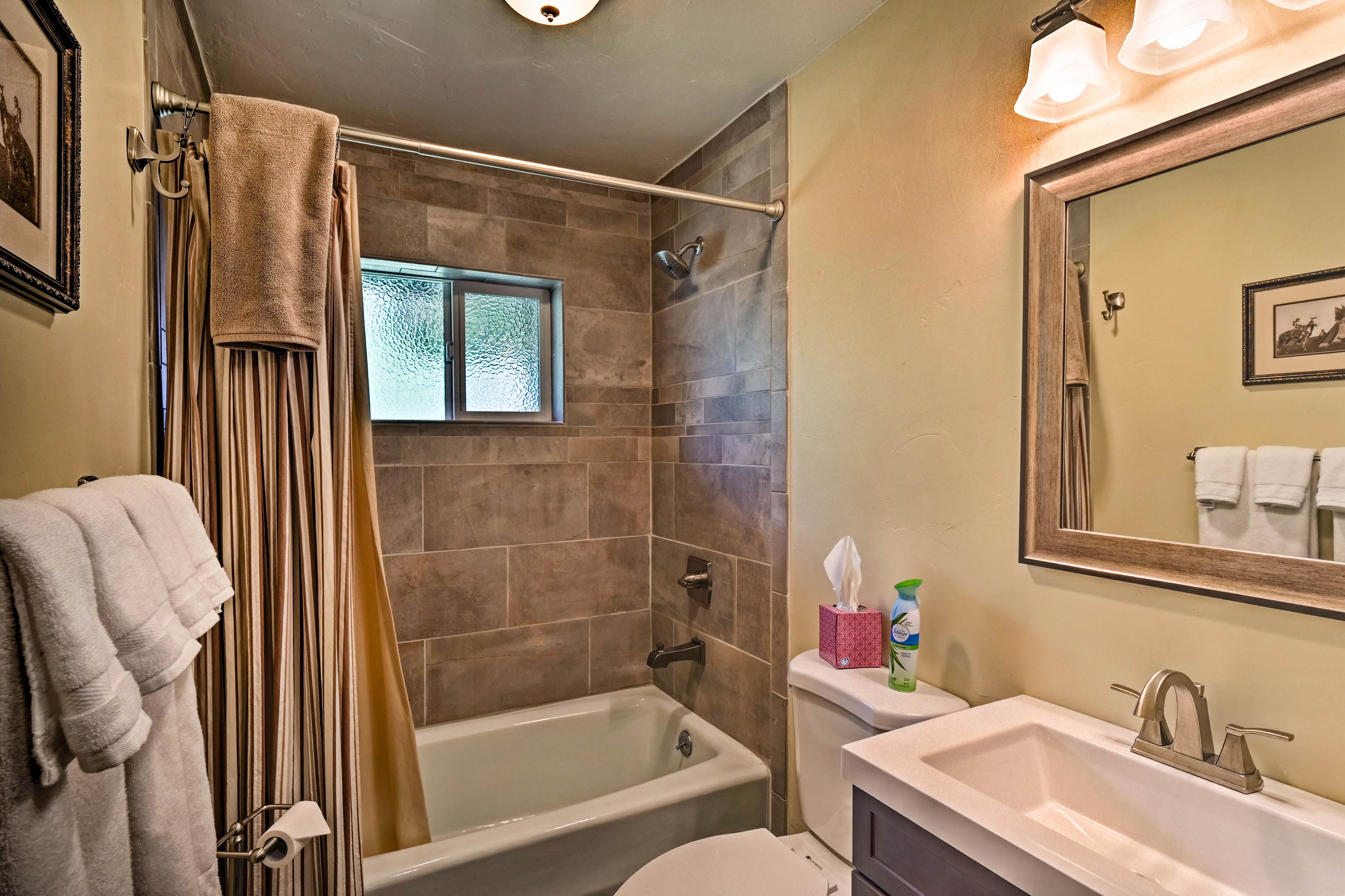 Rinse off after activities in the mountains in this tiled shower/tub combo.