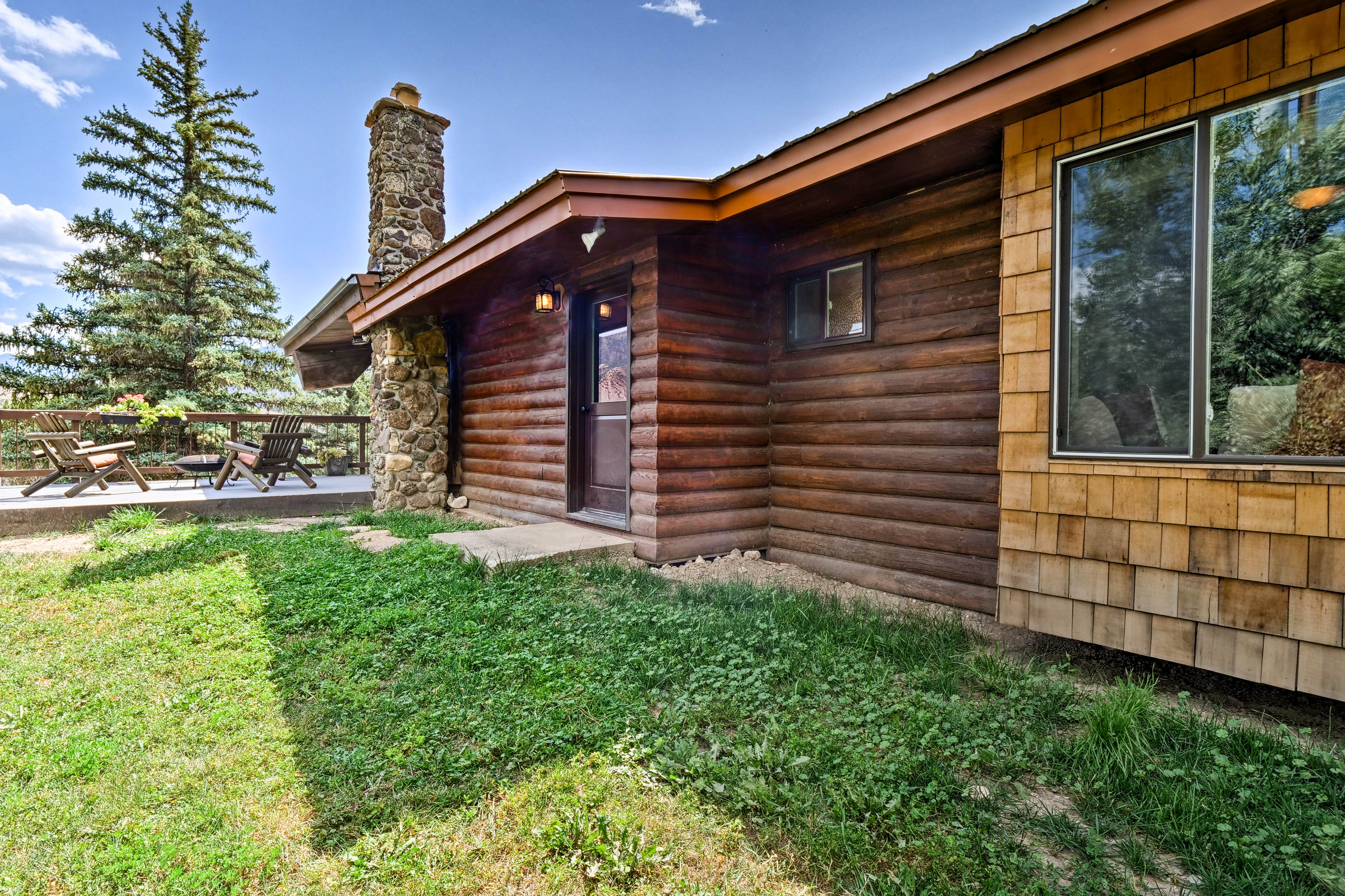 The chimney boasts a gorgeous flagstone exterior.