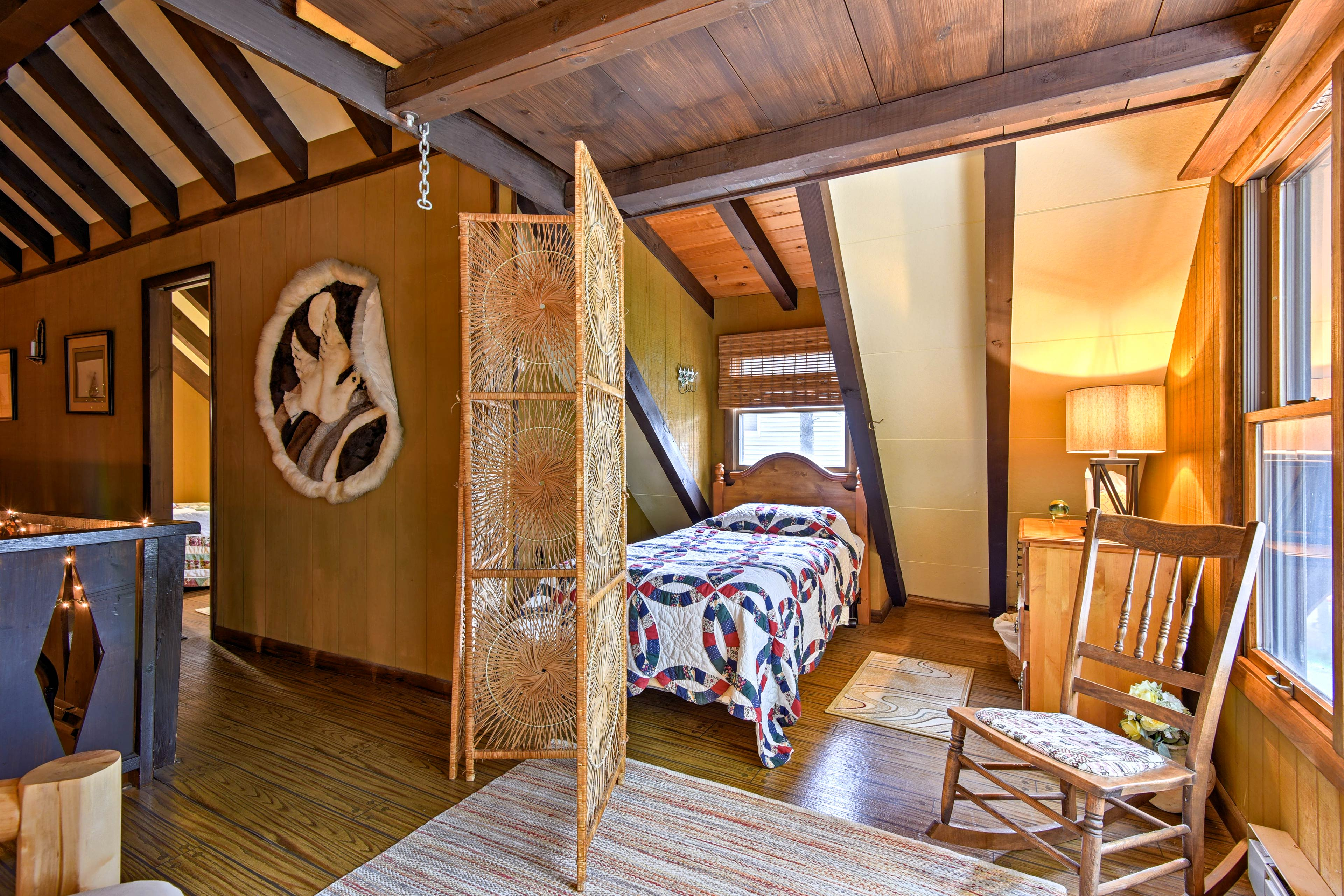 The loft has extra sleeping spaces, like this semi-private twin bed.