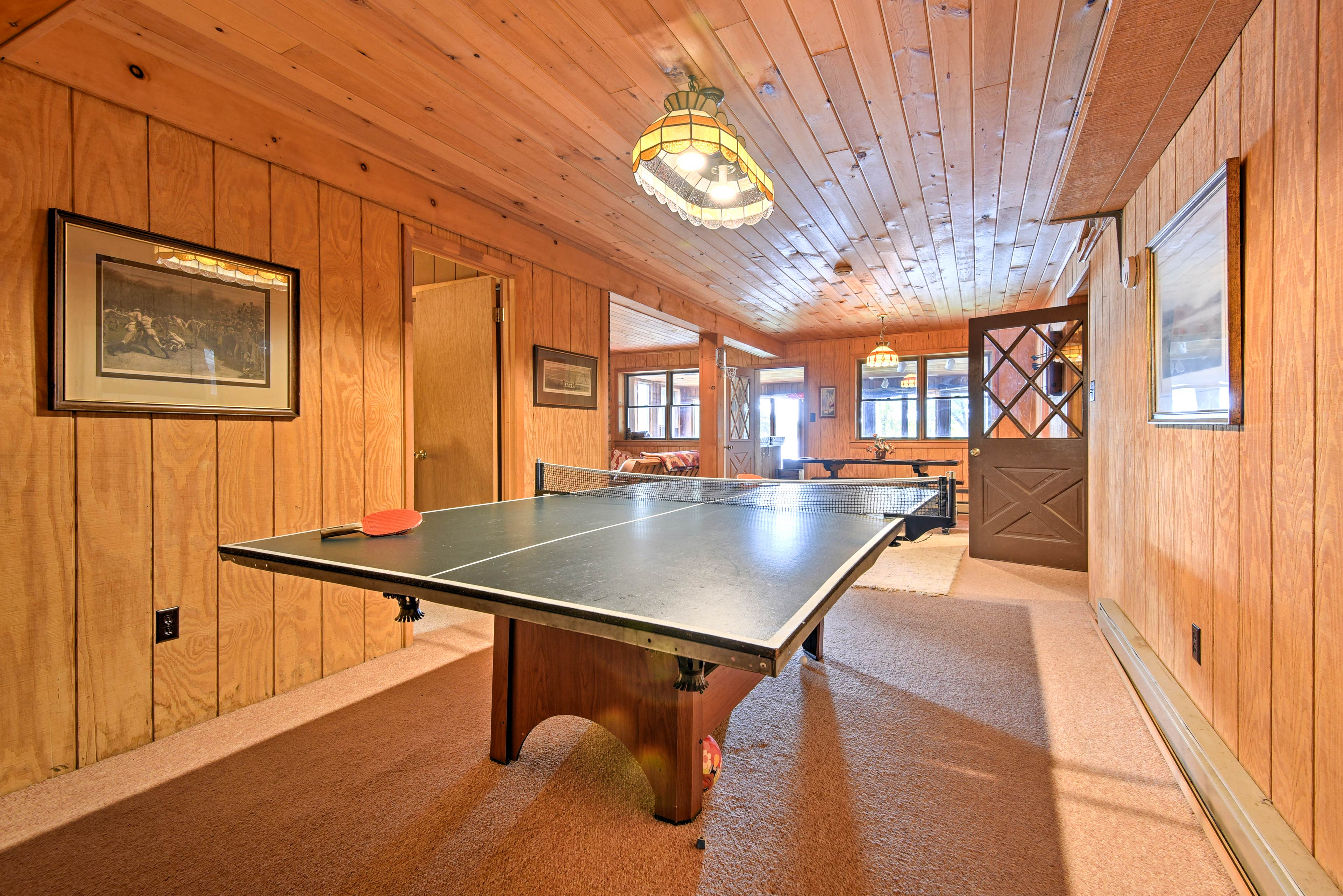 Downstairs is the game room with a ping-pong table.