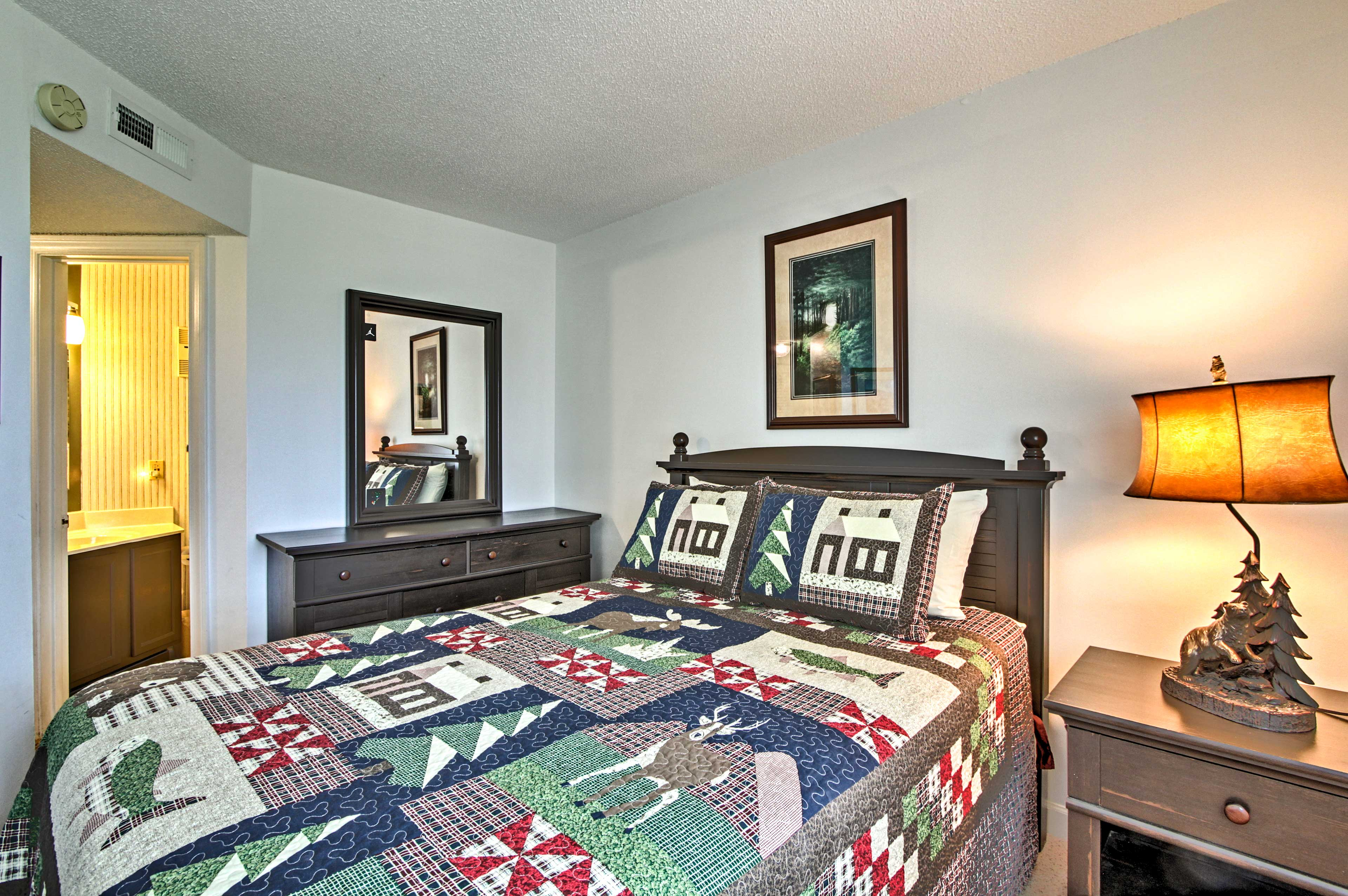 This queen bedroom boasts an en-suite bathroom.