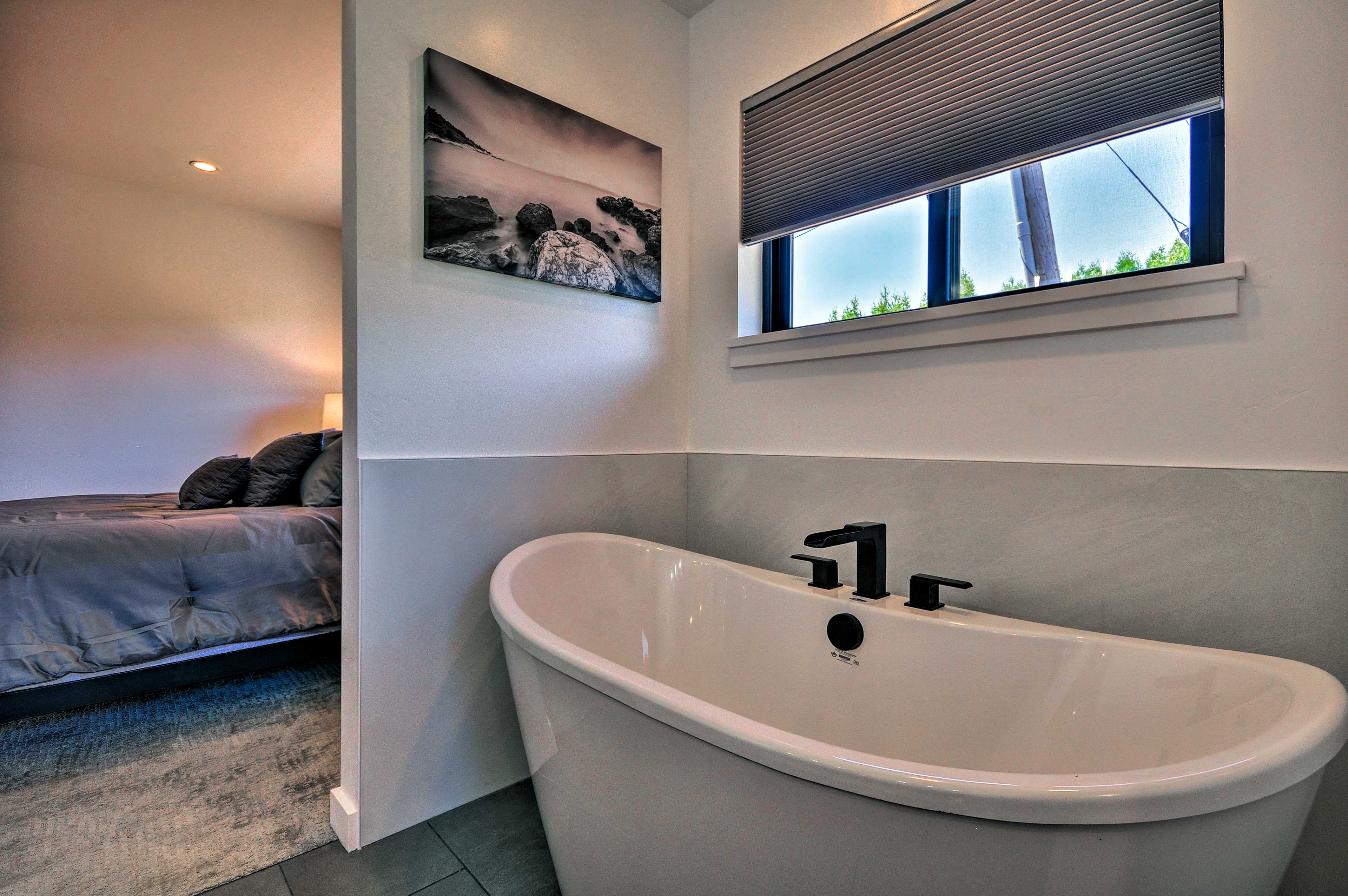Enjoy a relaxing soak in the large tub.
