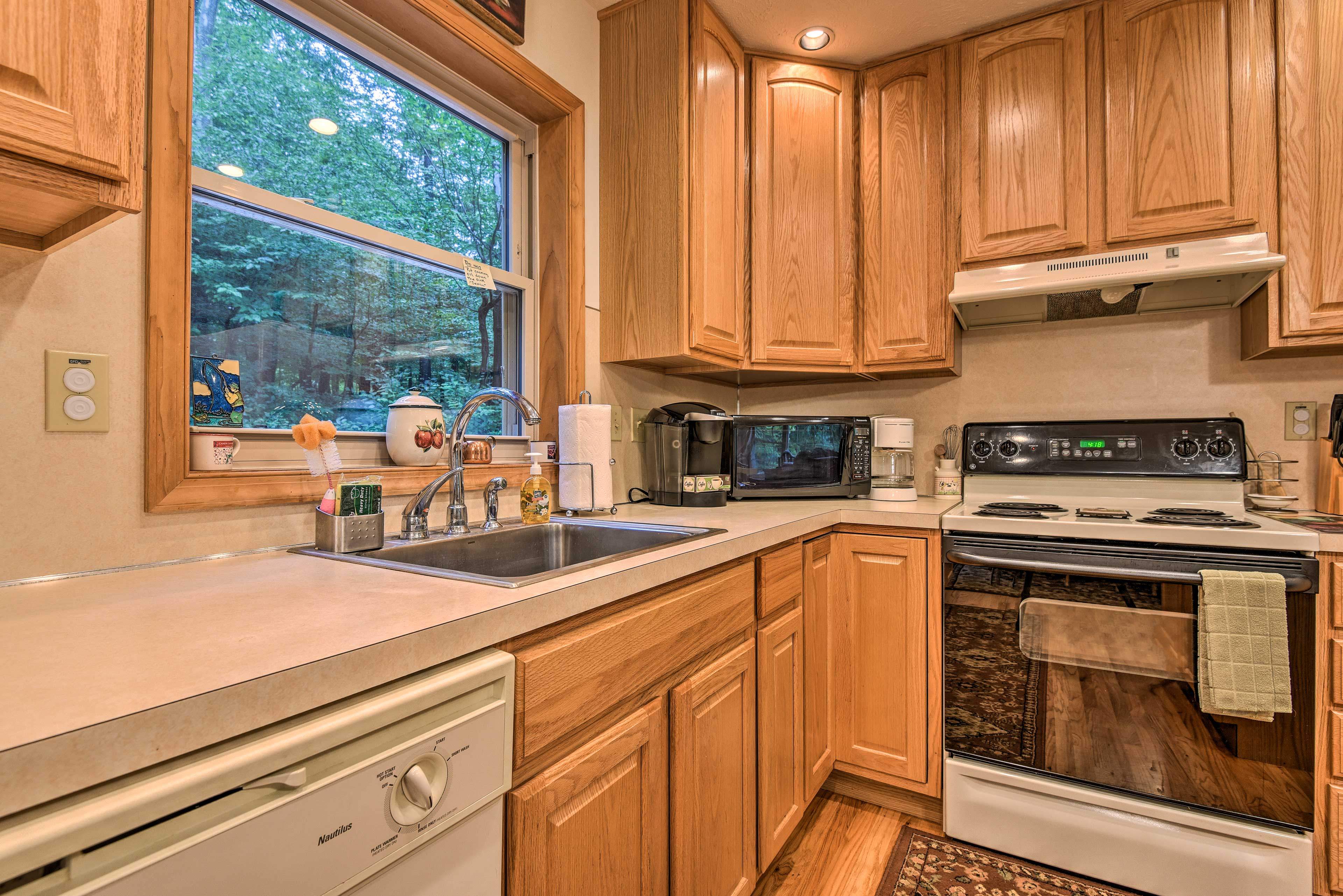 The kitchen is fully equipped with all appliances necessary.