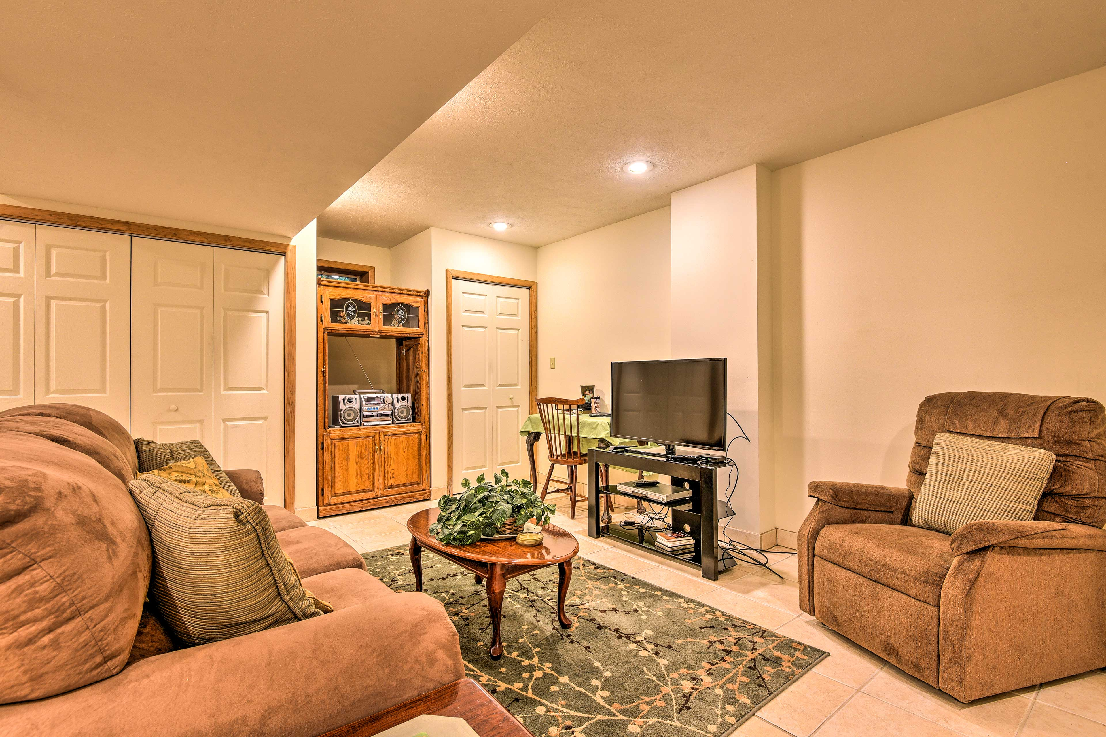 The Rec room features a flat-screen cable Smart TV and sleeper sofa.