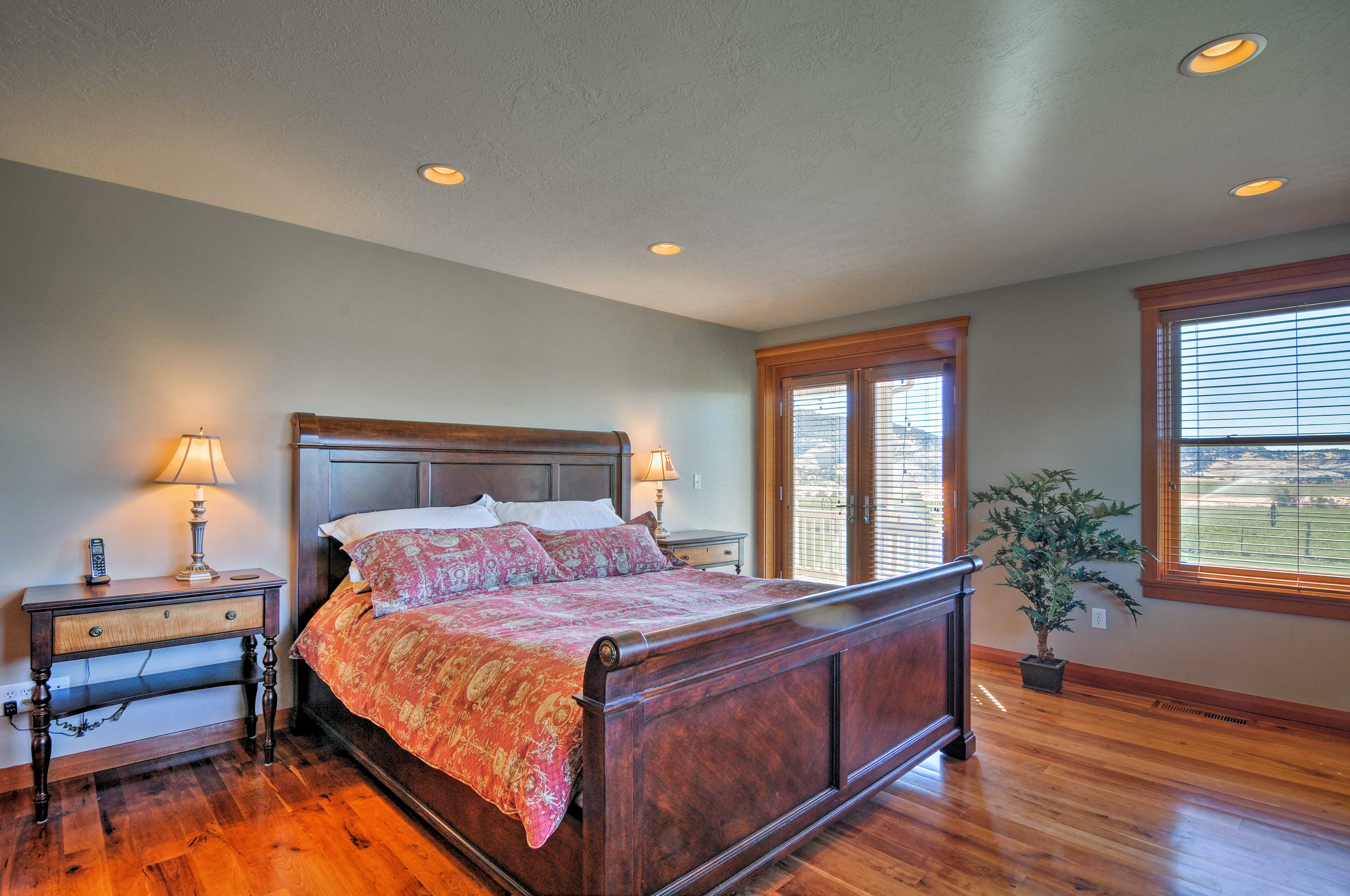 The master bedrooms sits on the ground floor & includes access to the porch.