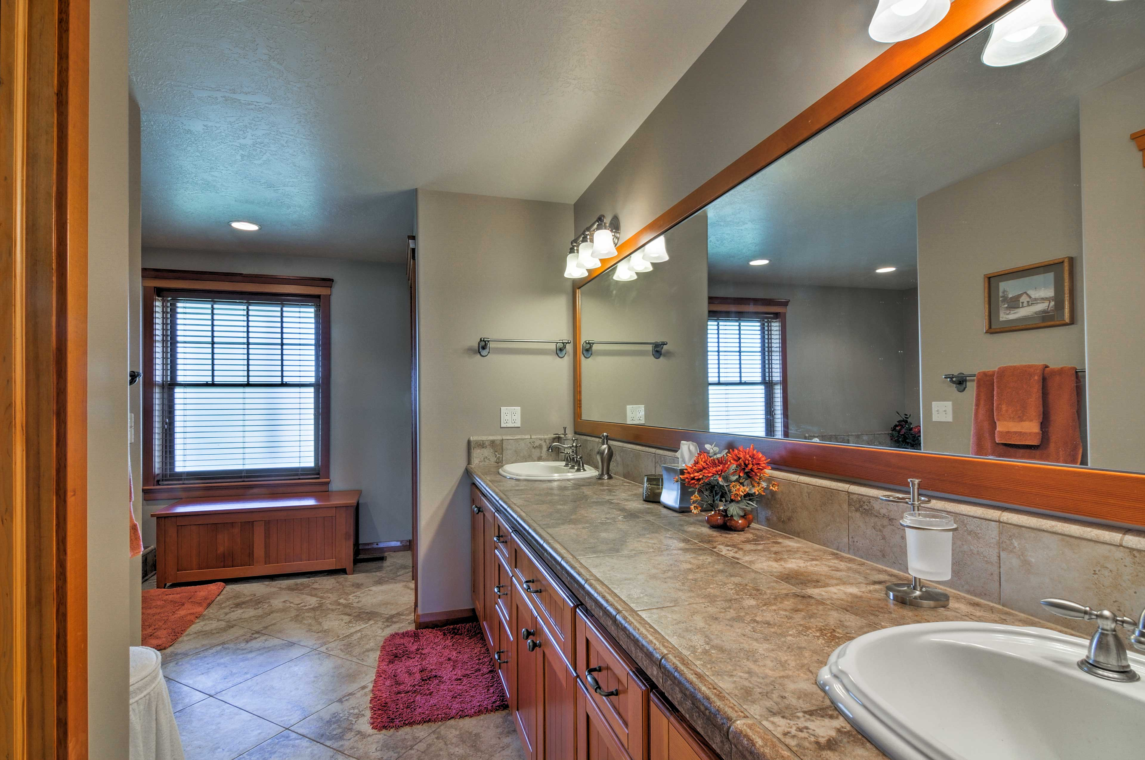 The master suite boasts a spacious private bath with an extensive double vanity.