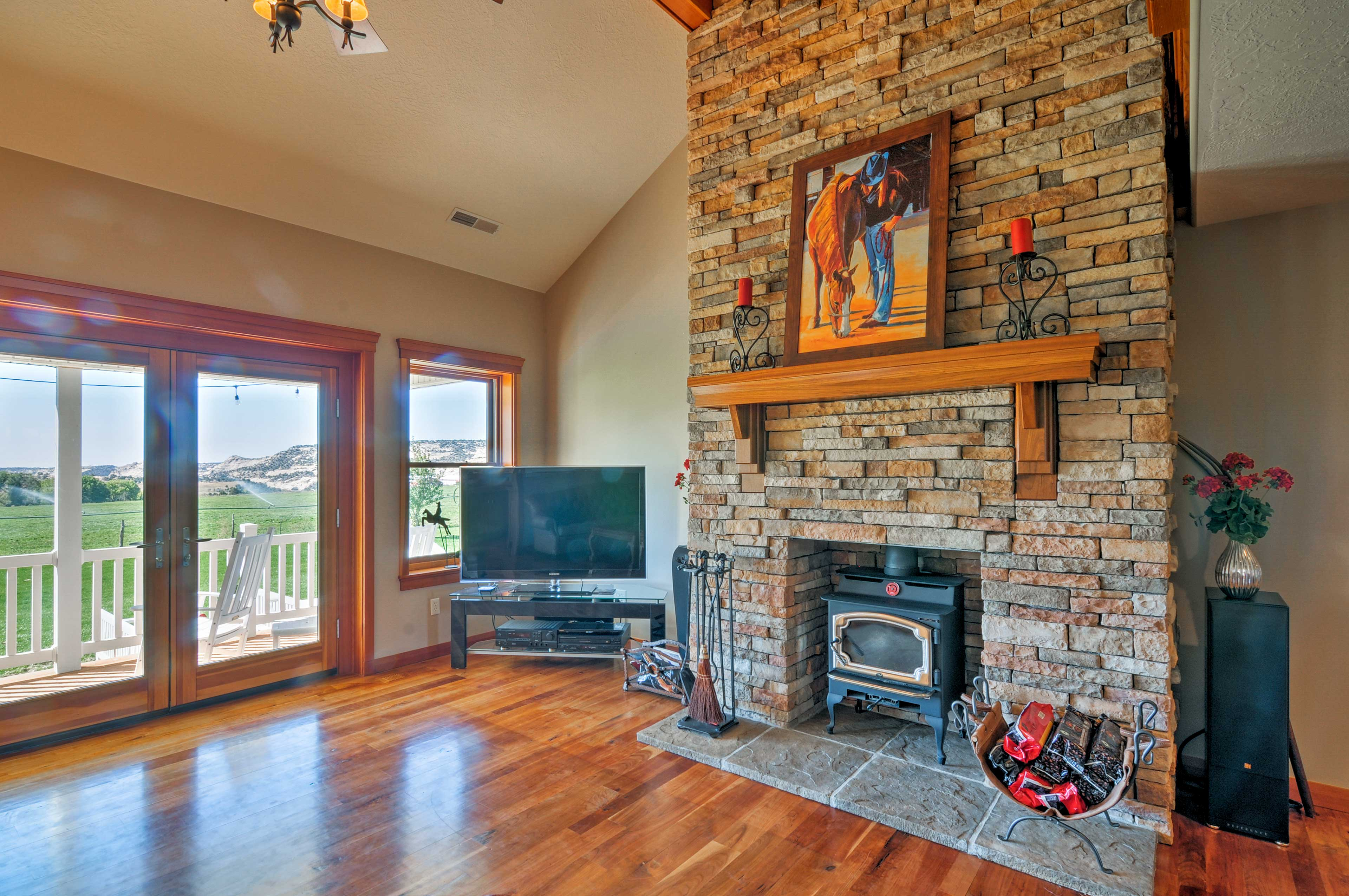 The living room features a flat-screen cable TV & wood-burning fireplace.
