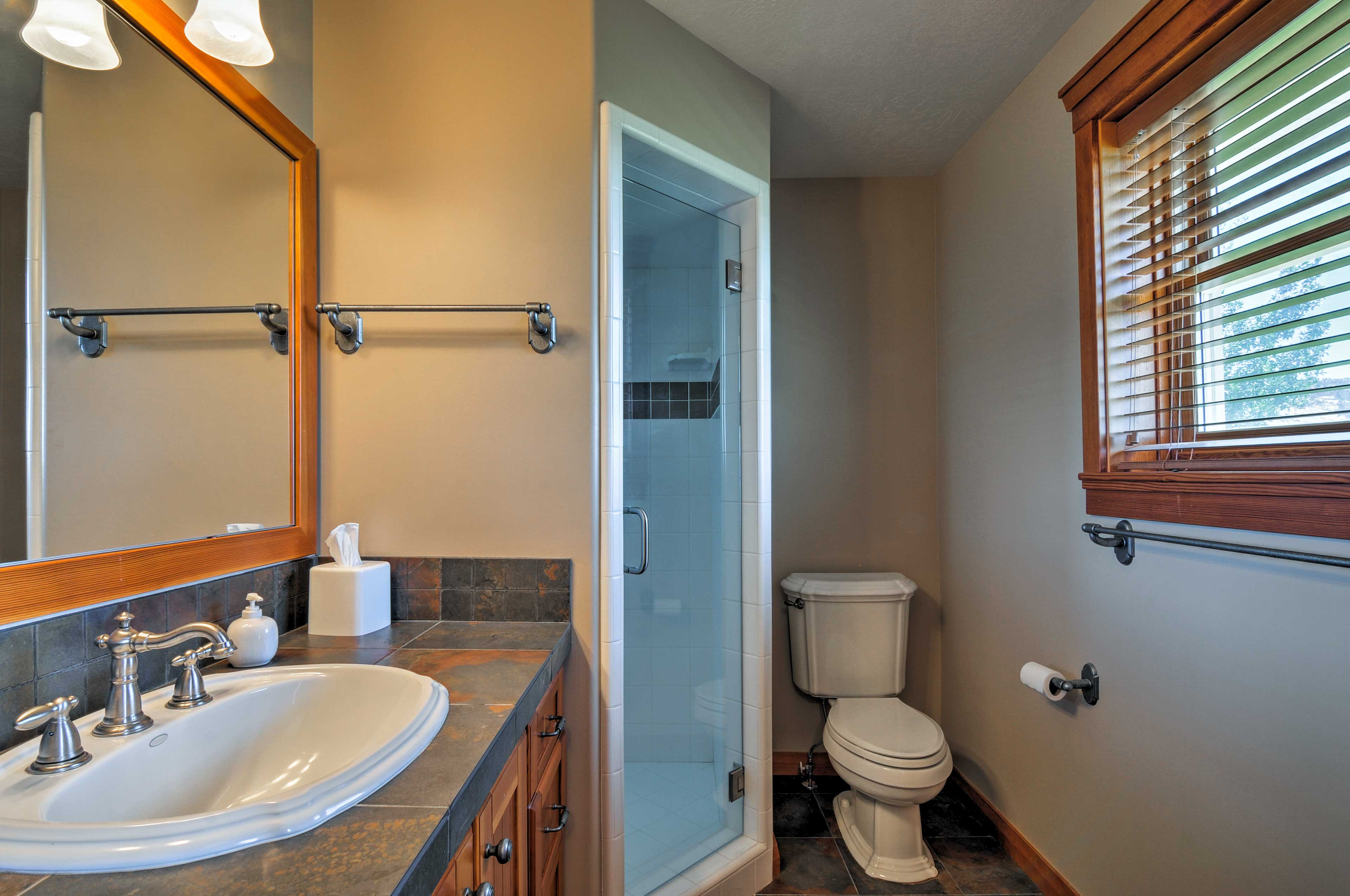 You'll love showering in this contemporary glass-doored walk-in.