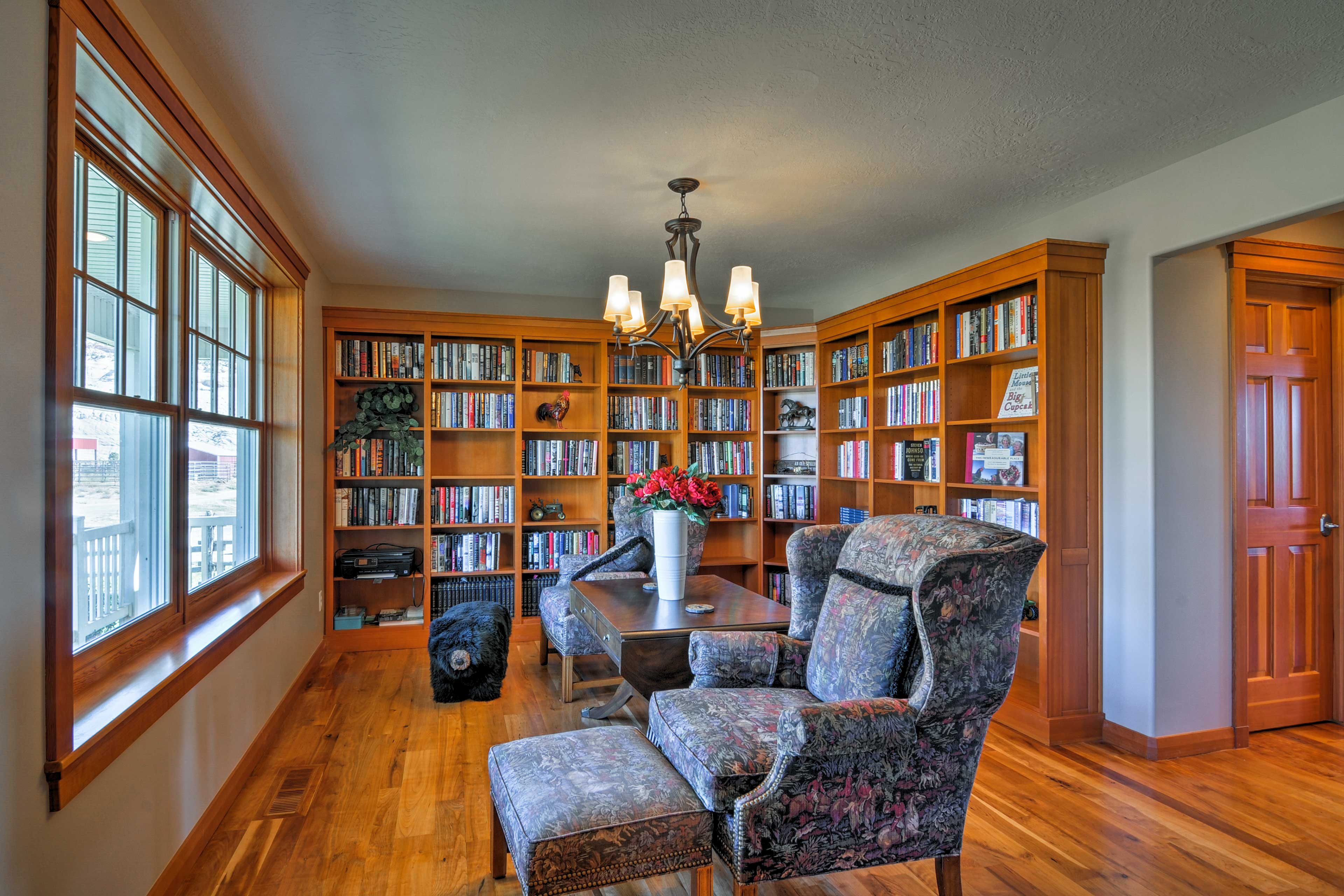 On the second floor, you'll find multiple bedrooms & this endearing library.