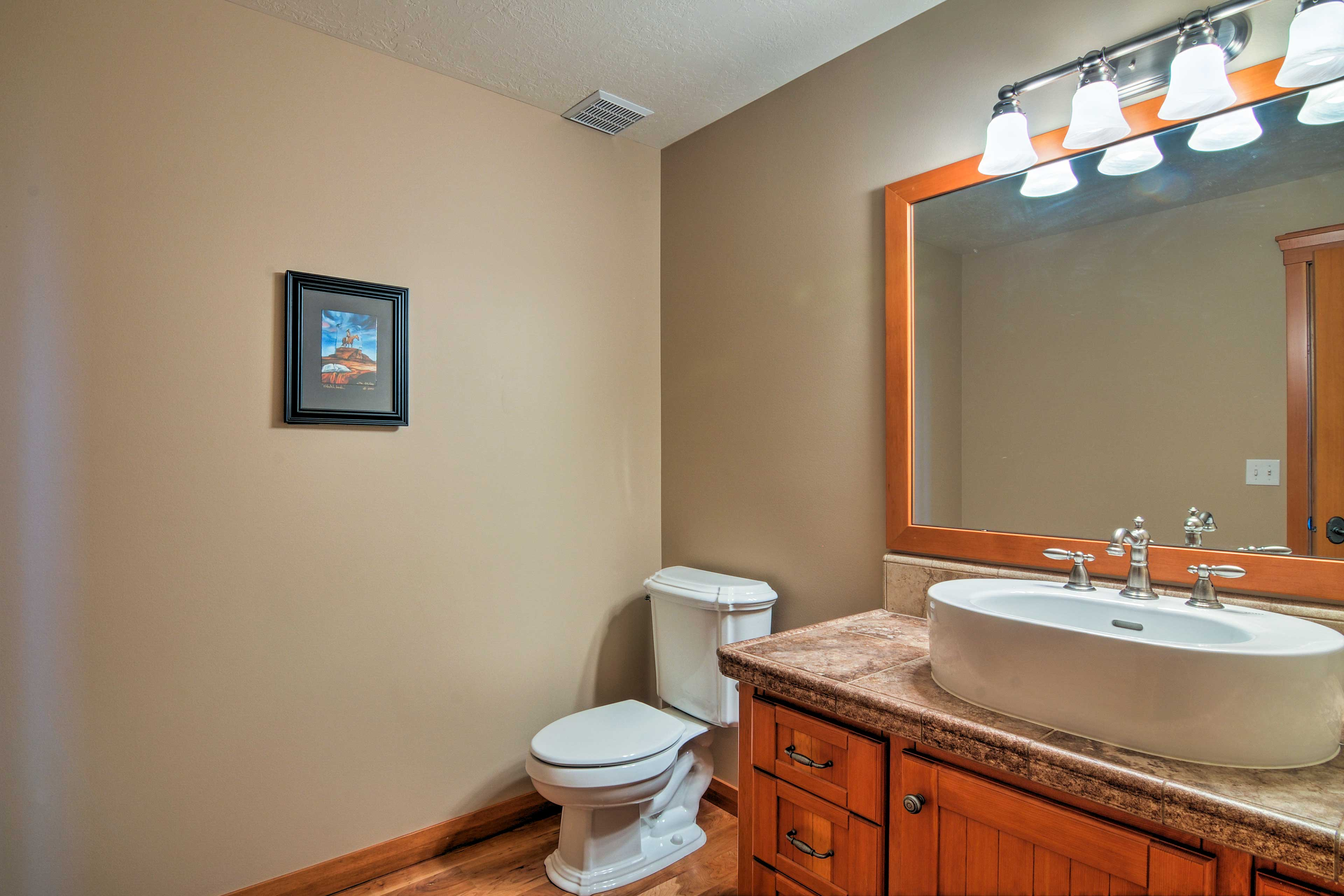 The large half bath is located on the ground floor of the ranch house.