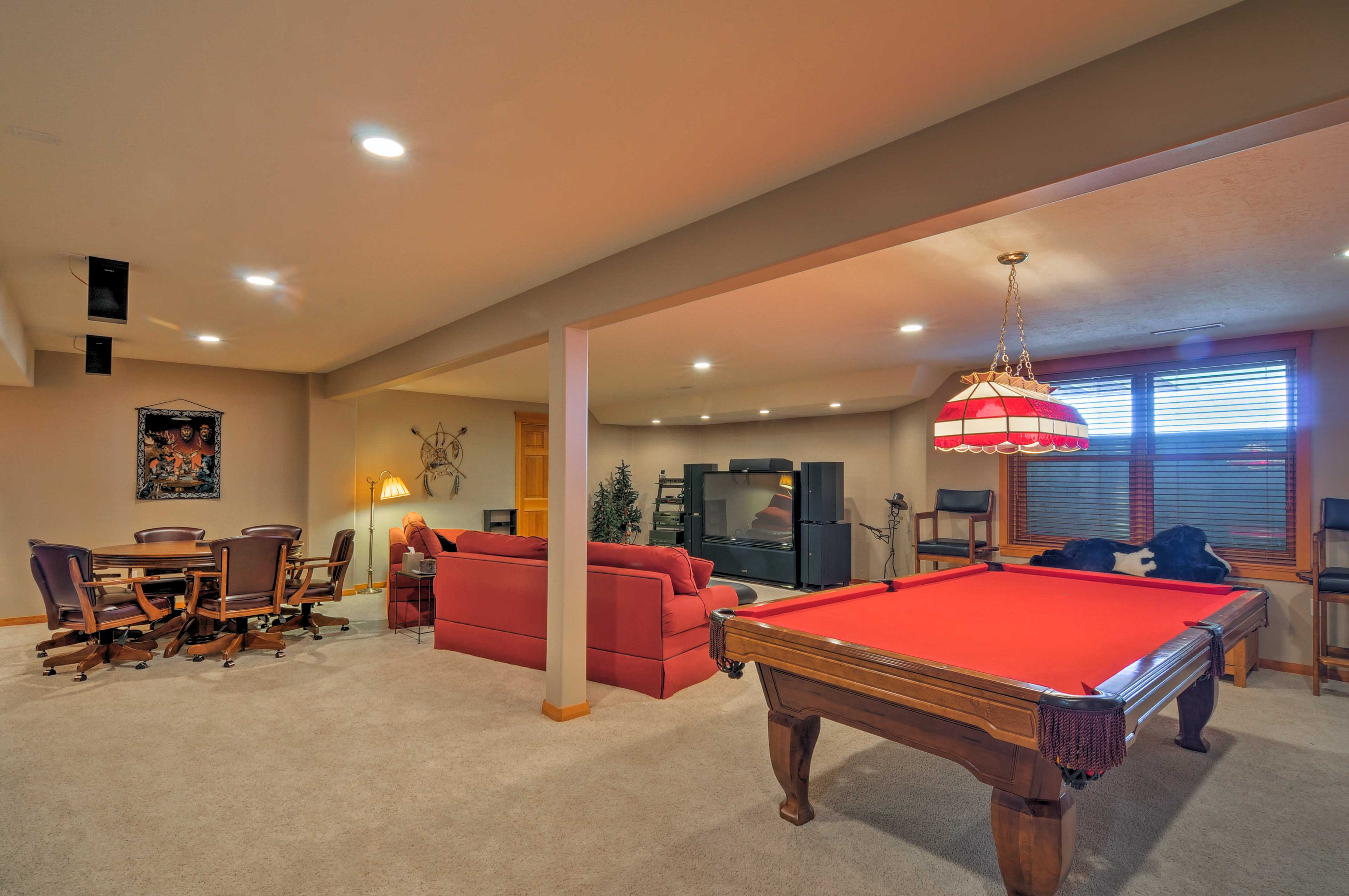 The expansive downstairs entertainment room is an ideal spot for lounging.