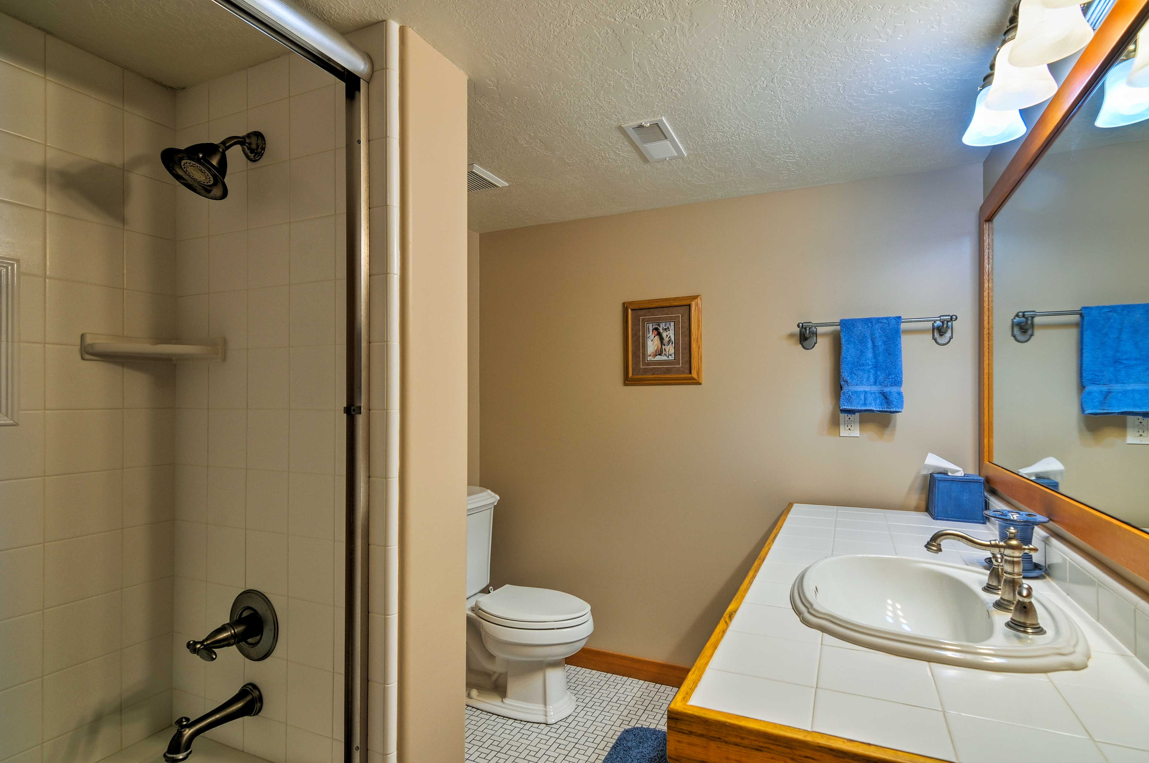Freshen up for the day in the fourth bathroom's large vanity & mirror.