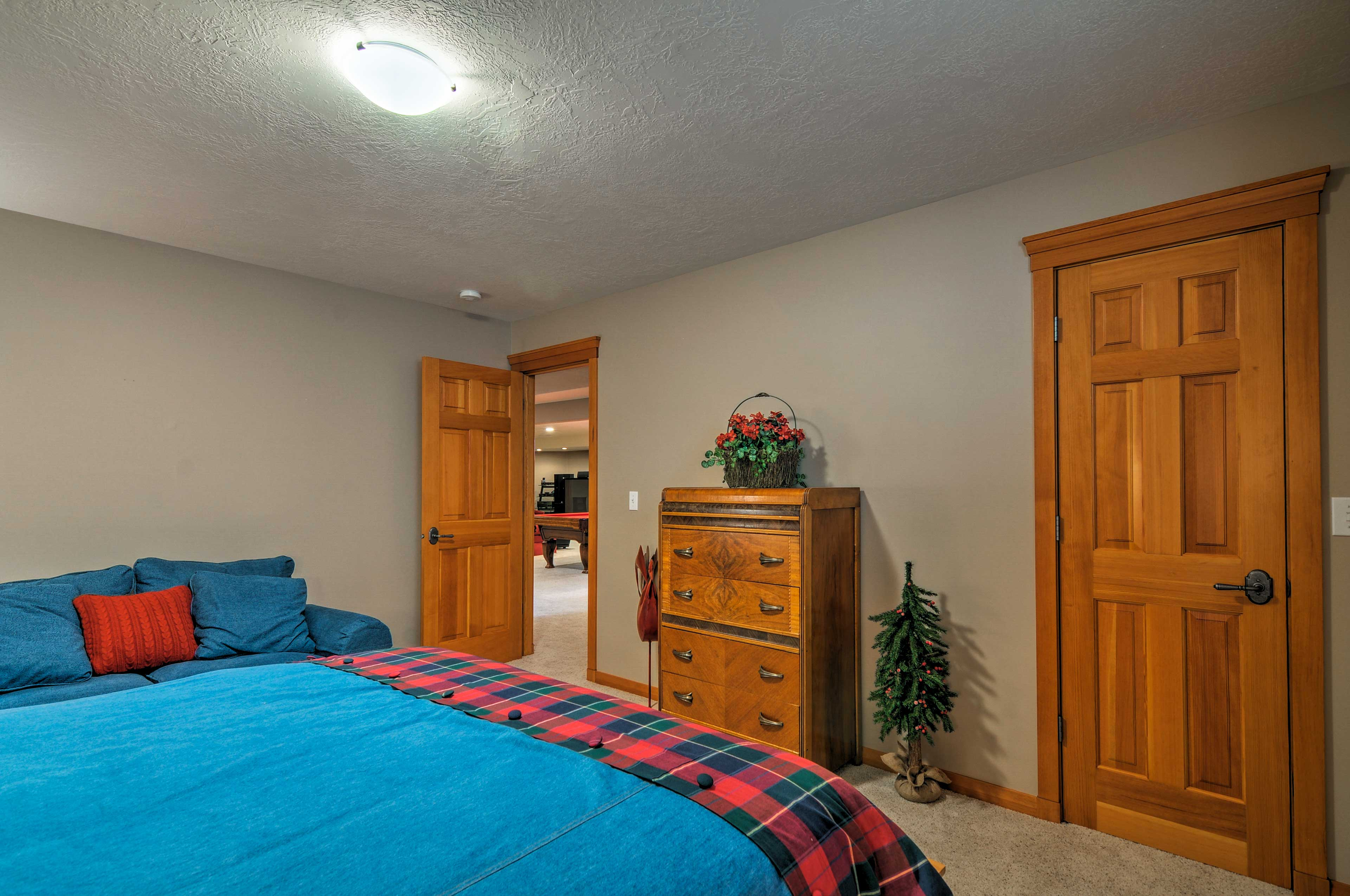 You'll find this bedroom downstairs just past the entertainment room.