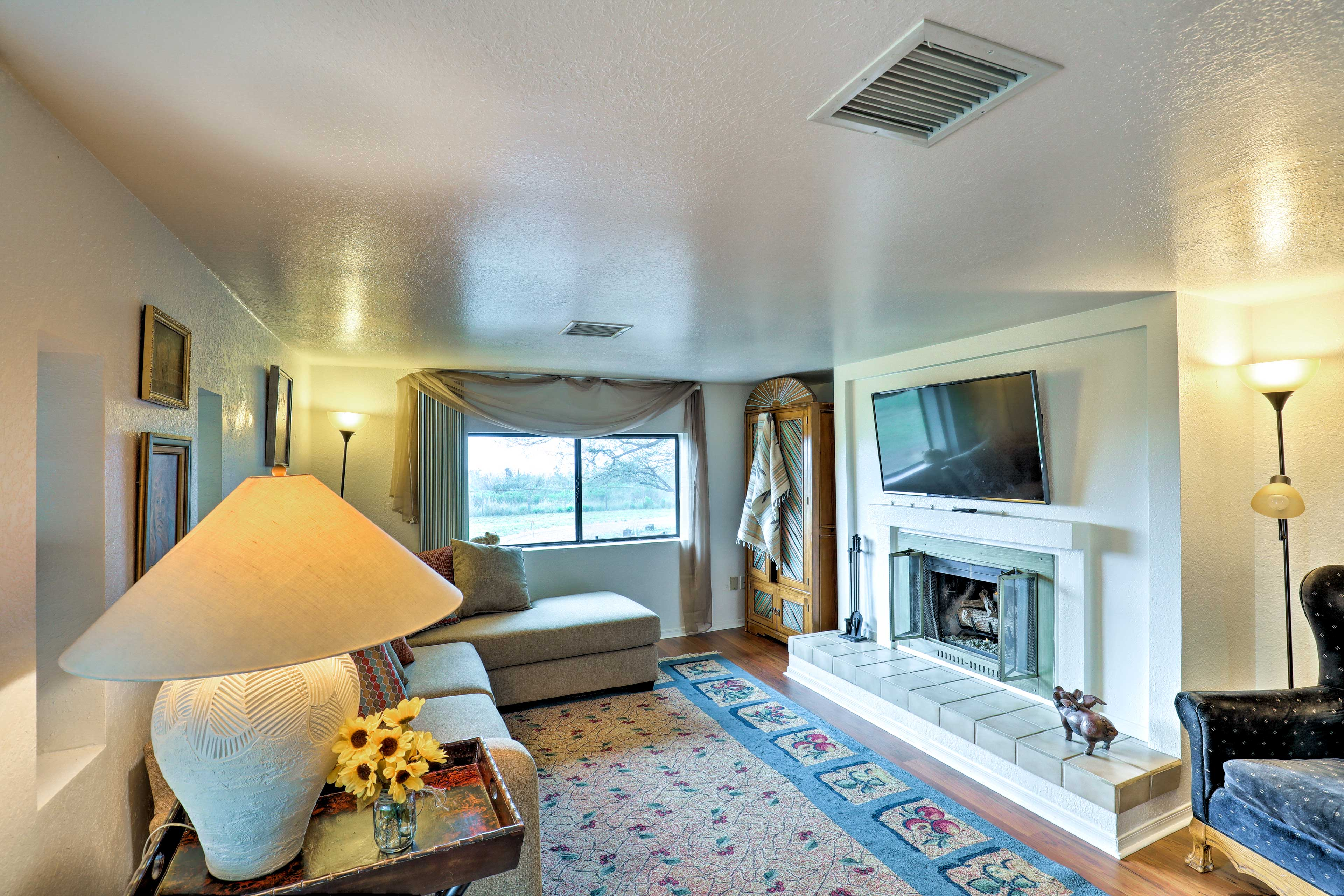 Relax in front of the mounted flat-screen Smart TV.