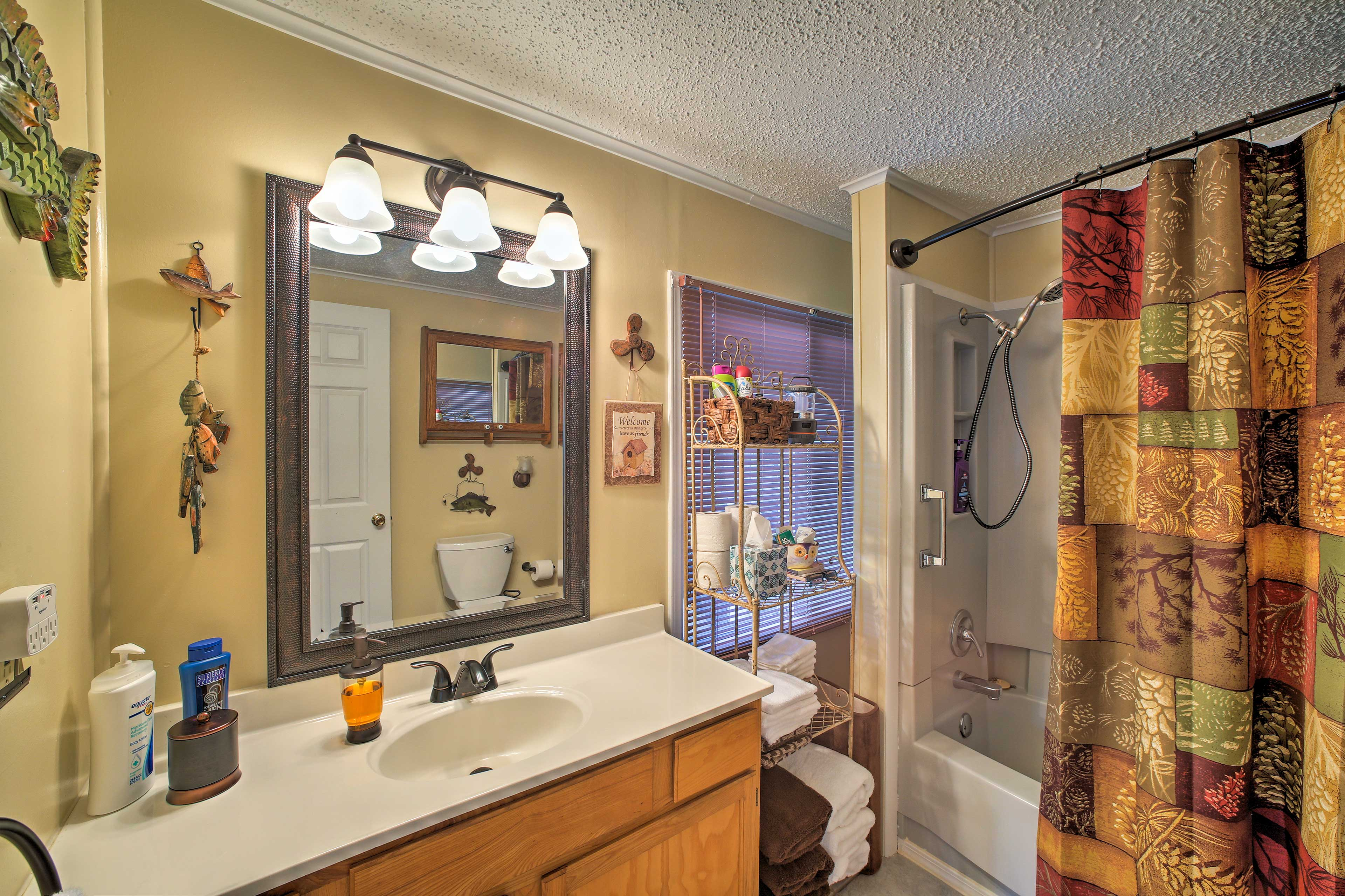The spacious bathroom offers plenty of room for everyone to get ready.