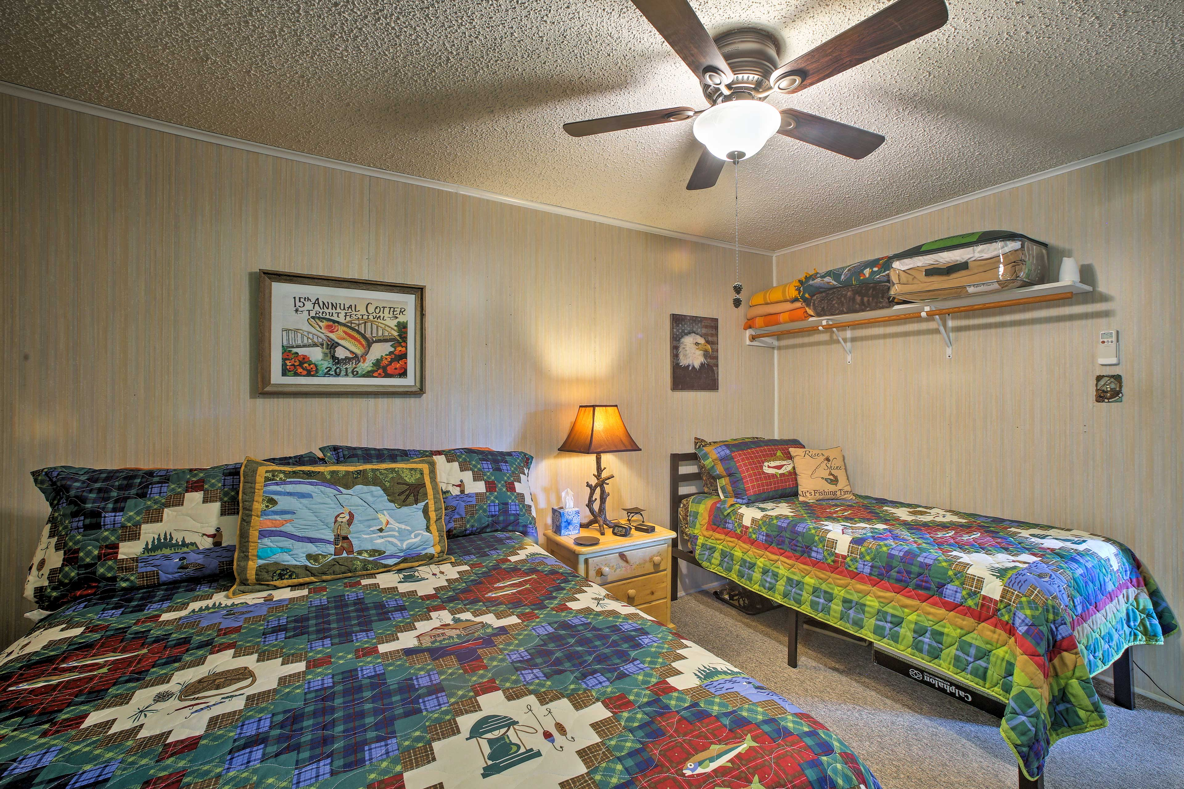 This bedrooms features a queen & twin bed.