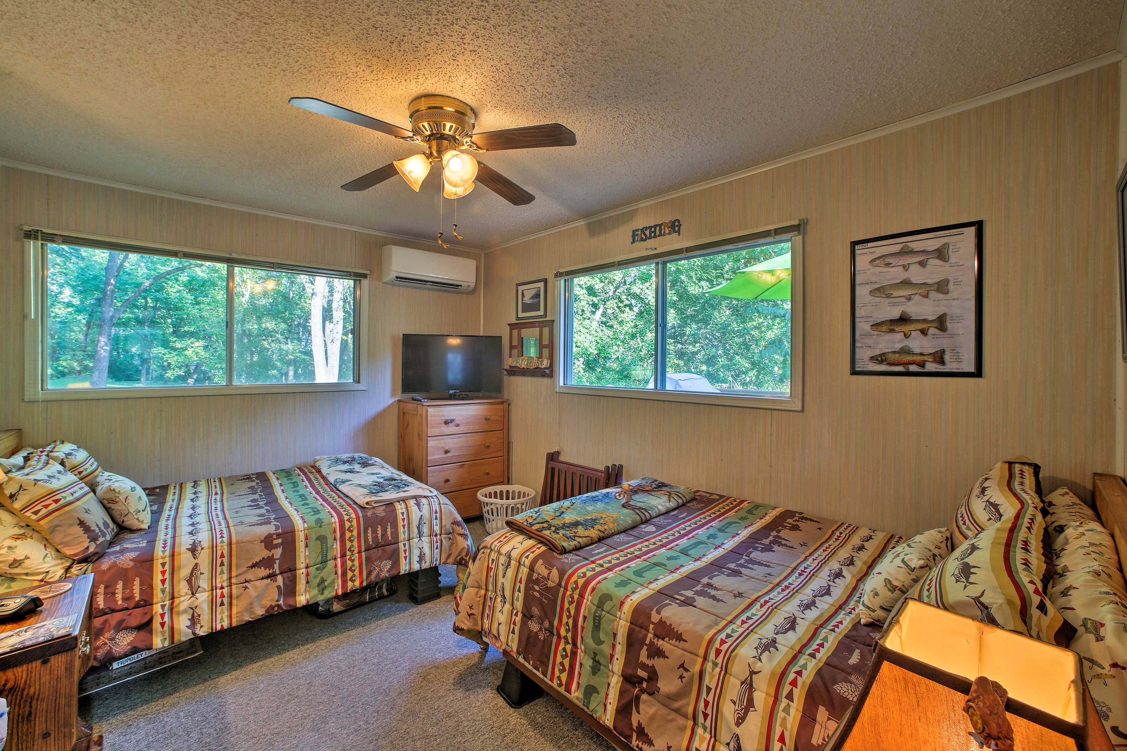 The second bedroom includes 2 full-sized beds.