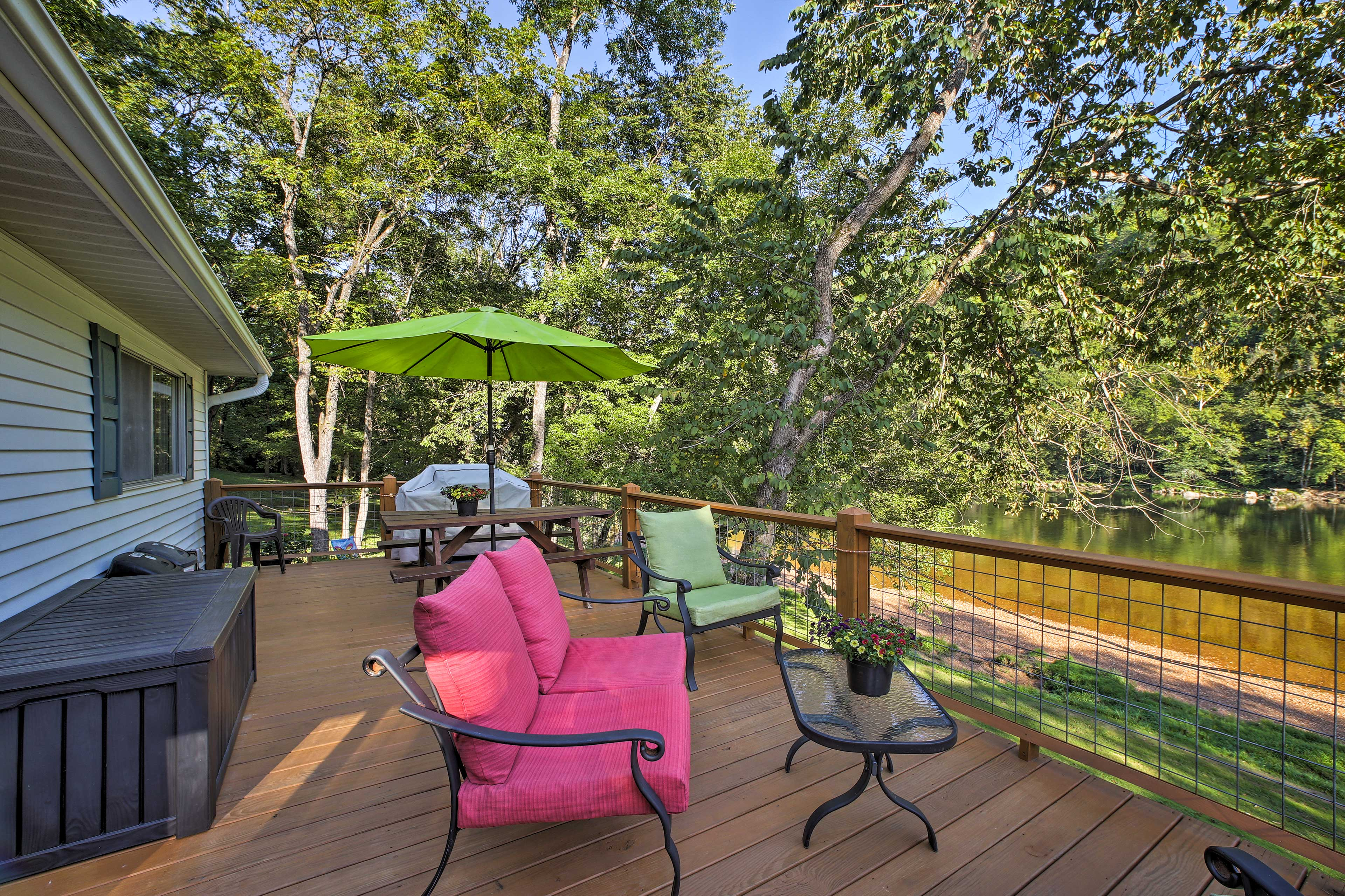You'll absolutely love lounging on this expansive deck overlooking the river.