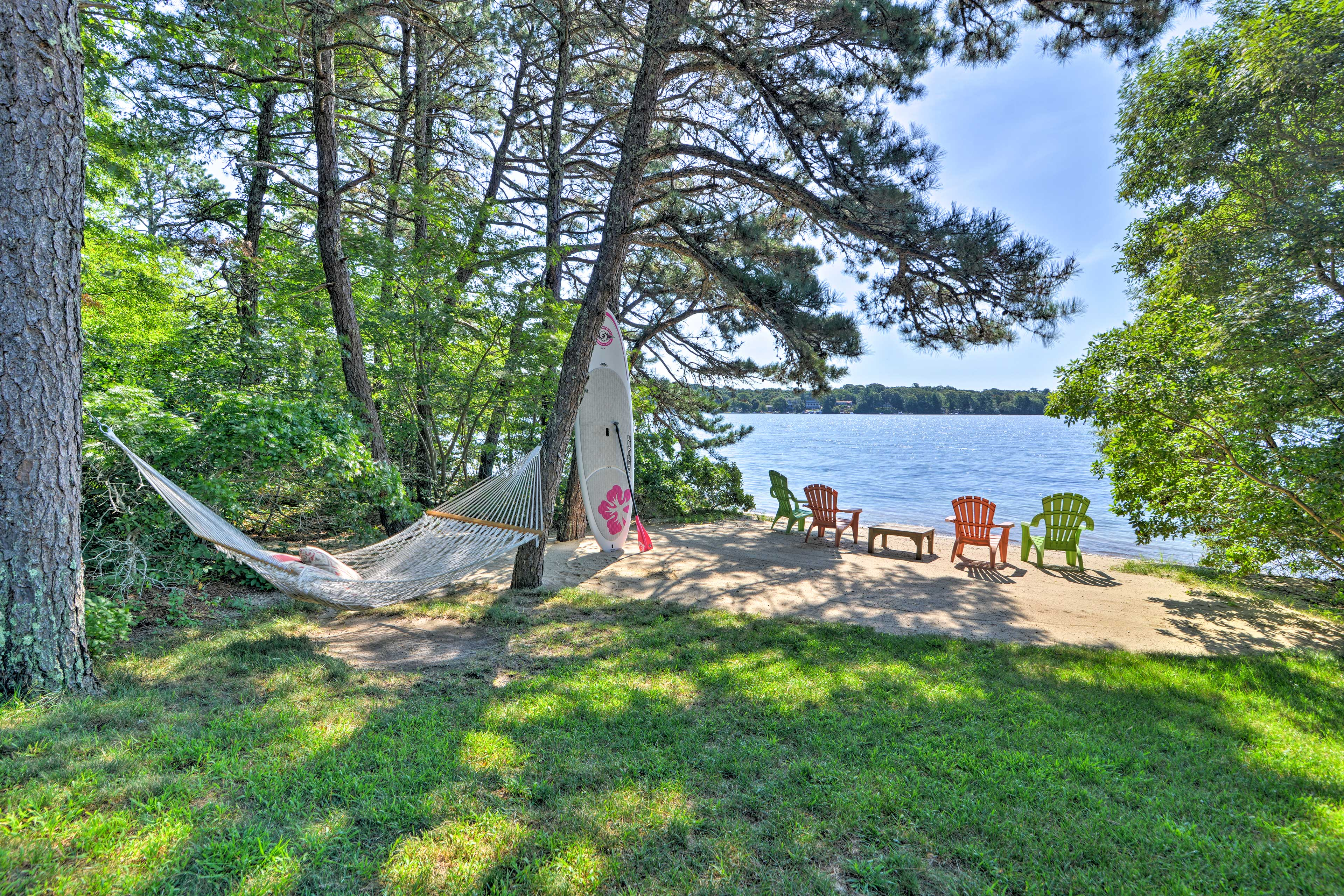 The home is located on Johns Pond and features a hammock, plus lounge area!